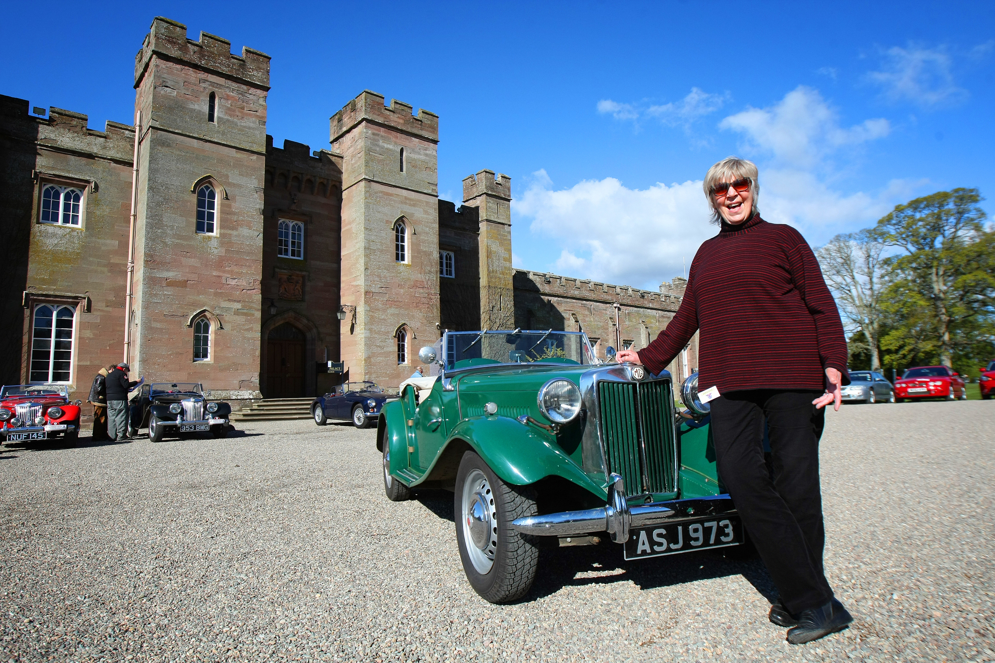 Anne Howitt with an MG TD outside Scone Palace