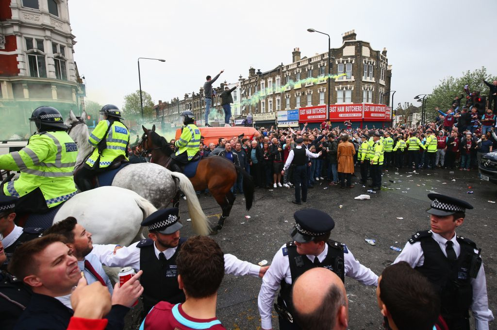 Police on patrol as fans enjoy the atmosphere outside the stadium prior to the Barclays Premier League match between West Ham United and Manchester United at the Boleyn Ground on May 10, 2016 in London, England. West Ham United are playing their last ever home match at the Boleyn Ground after their 112 year stay at the stadium. The Hammers will move to the Olympic Stadium for the 2016-17 season. (Photo by Paul Gilham/Getty Images)