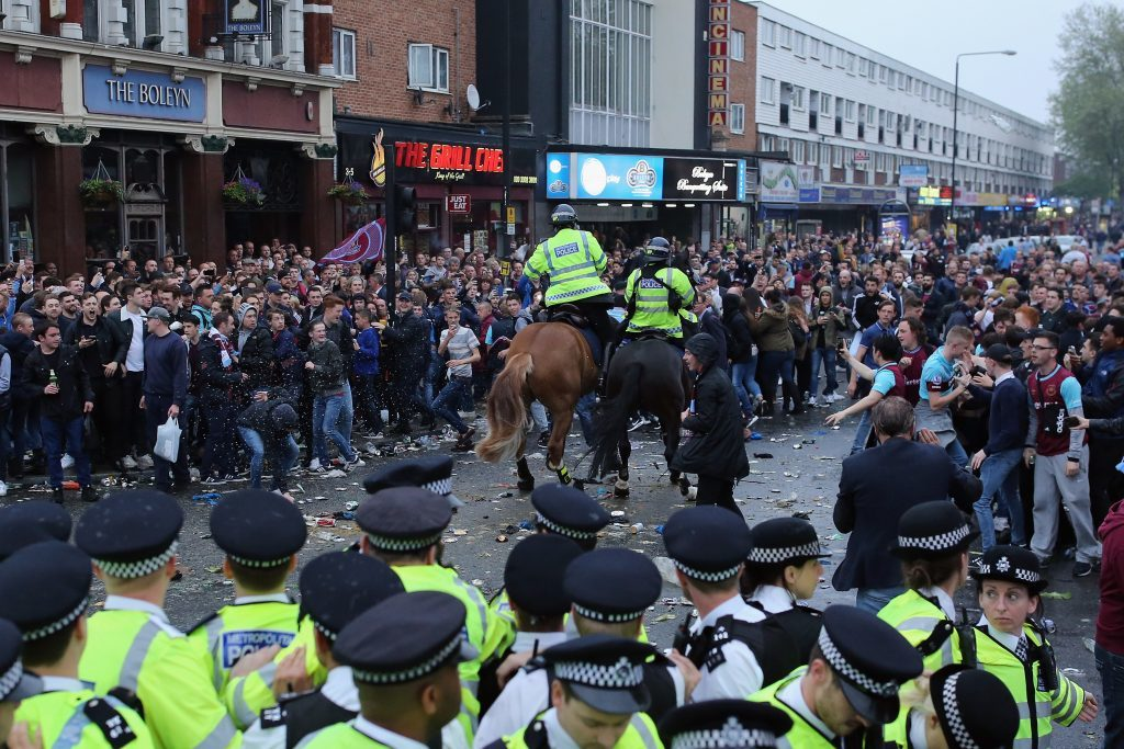 LONDON, ENGLAND - MAY 10: Police horses charge at West Ham fans as they become violent and start throwing bottles at police outside the West Ham United FC's Boleyn Ground on May 10, 2016 in London, England. Tonights Premier League match against Manchester United is West Ham United's last game at the Boleyn Ground, bringing to an end 112 years of the club's history at the ground. The club will move into the Olympic Stadium next season, making way for developers and plans for 800 new homes where the stadium now stands. (Photo by Dan Kitwood/Getty Images)