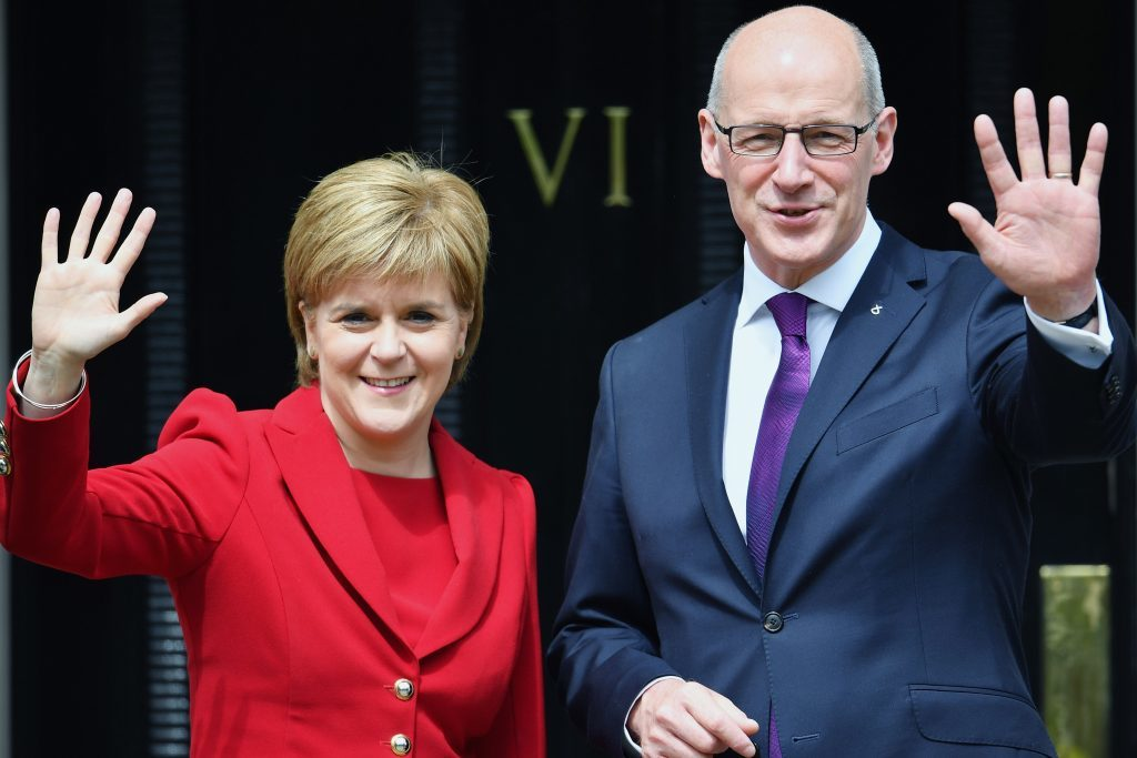 First Minister Nicola Sturgeon and her Deputy First Minister John Swinney .