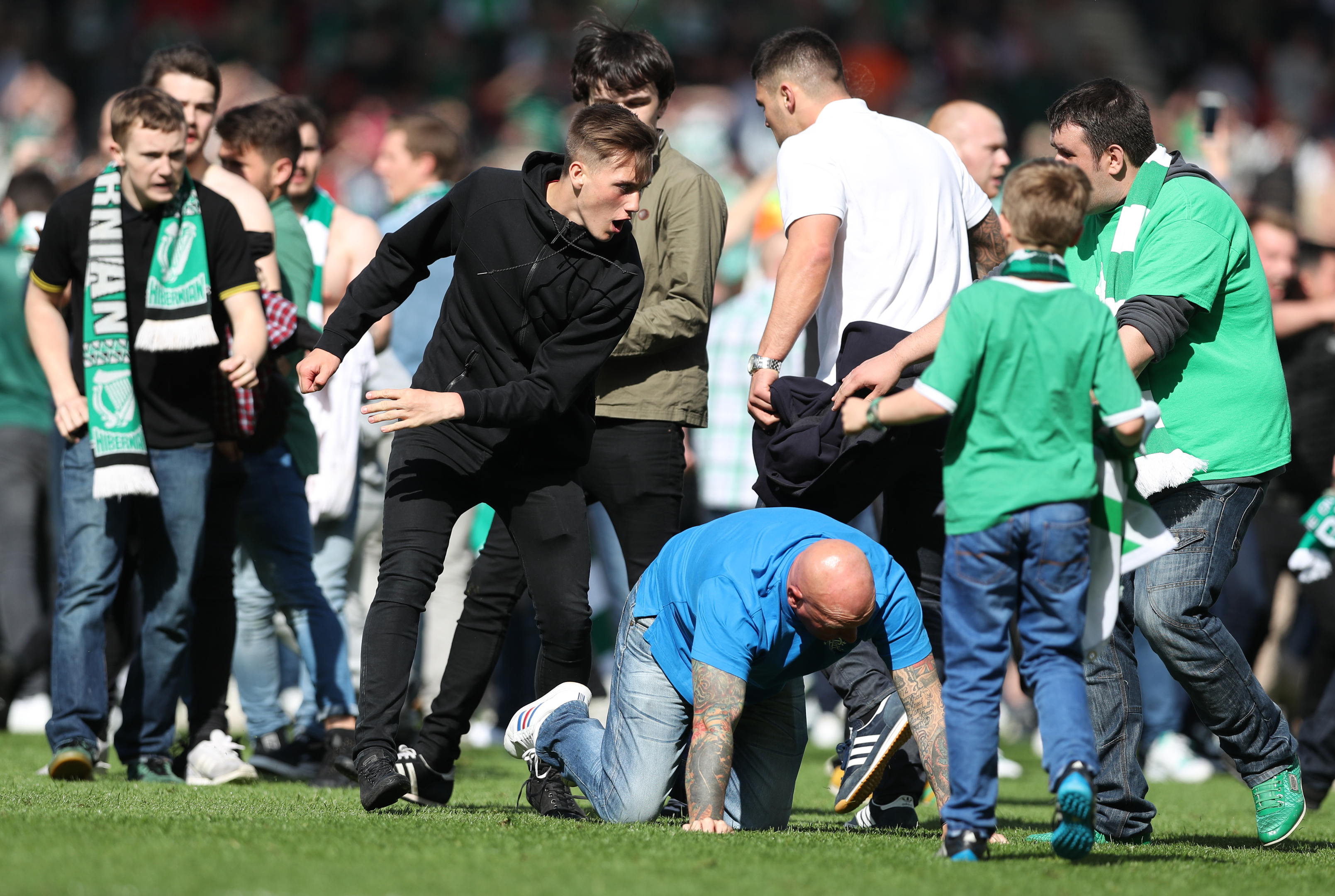 Fans fight on the pitch after the Scottish Cup Final between Rangers and Hibernian.