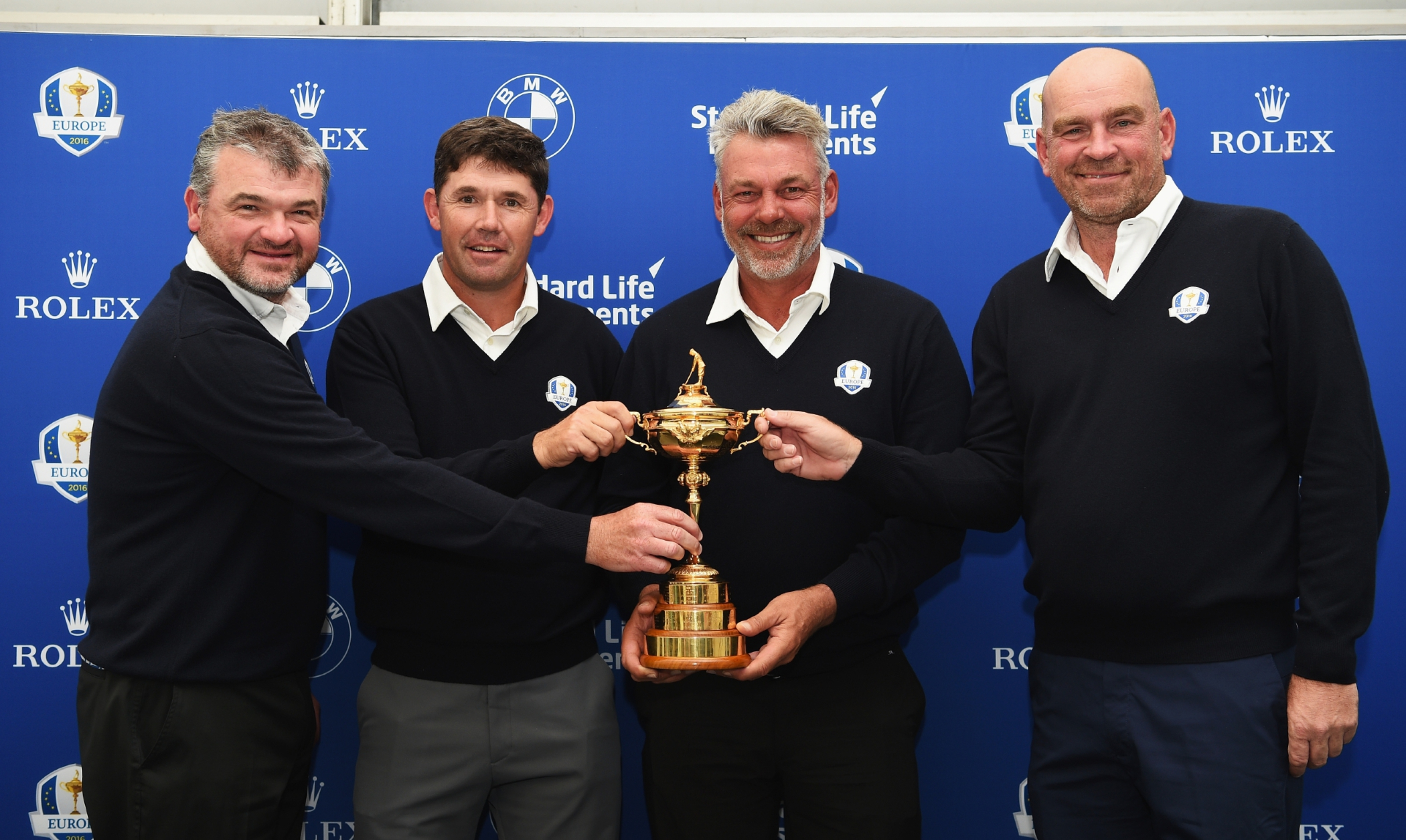 Paul Lawrie (left) has been doing spying duries for European Ryder Cup captain Darren Clarke.
