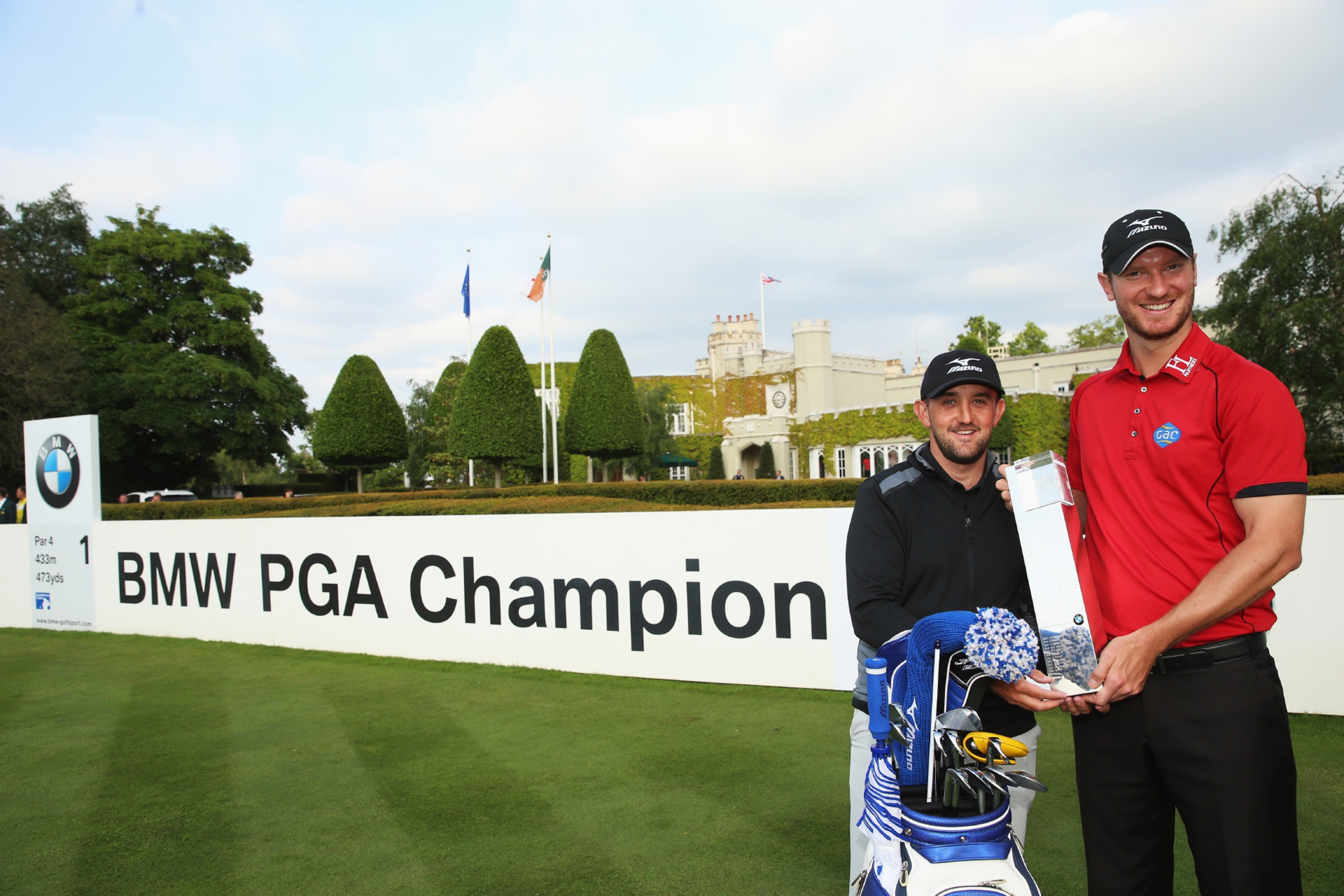 Chris Wood and Scottish caddie Mark Crane following the Englishman's BMW PGA victory.