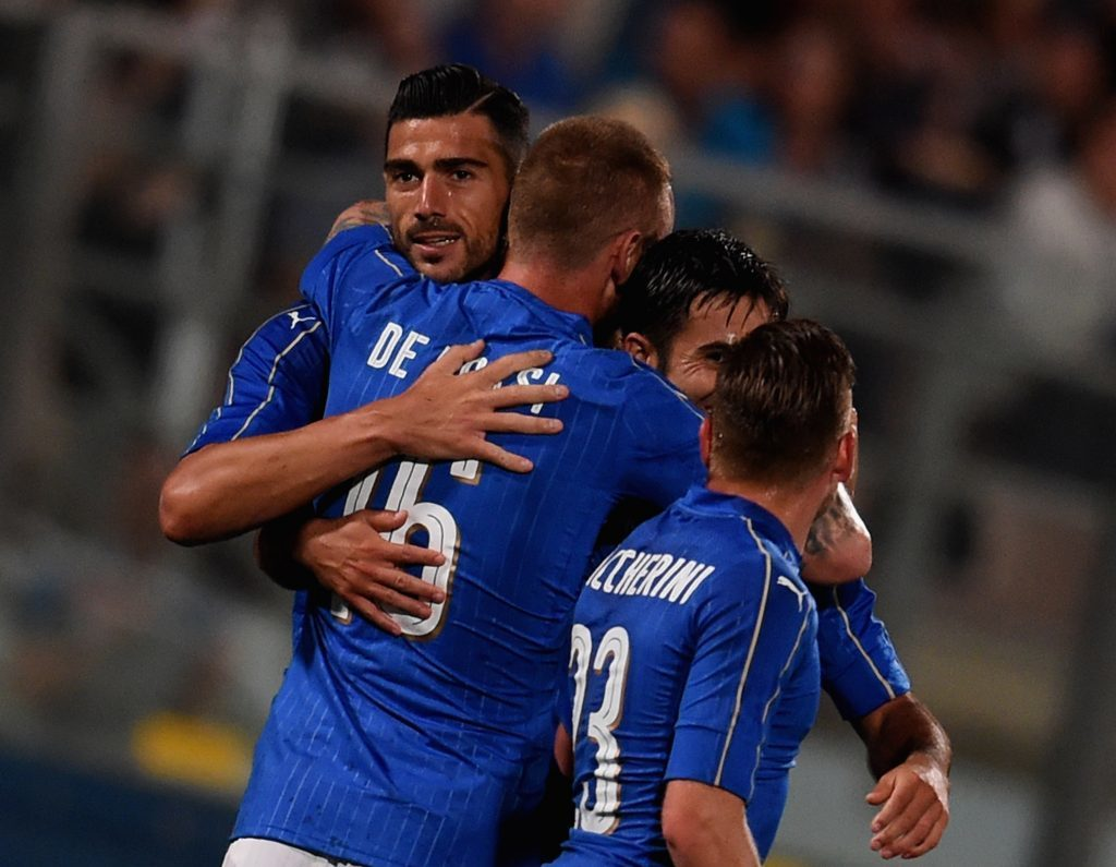 Graziano Pelle of Italy (L) celebrates after scoring.