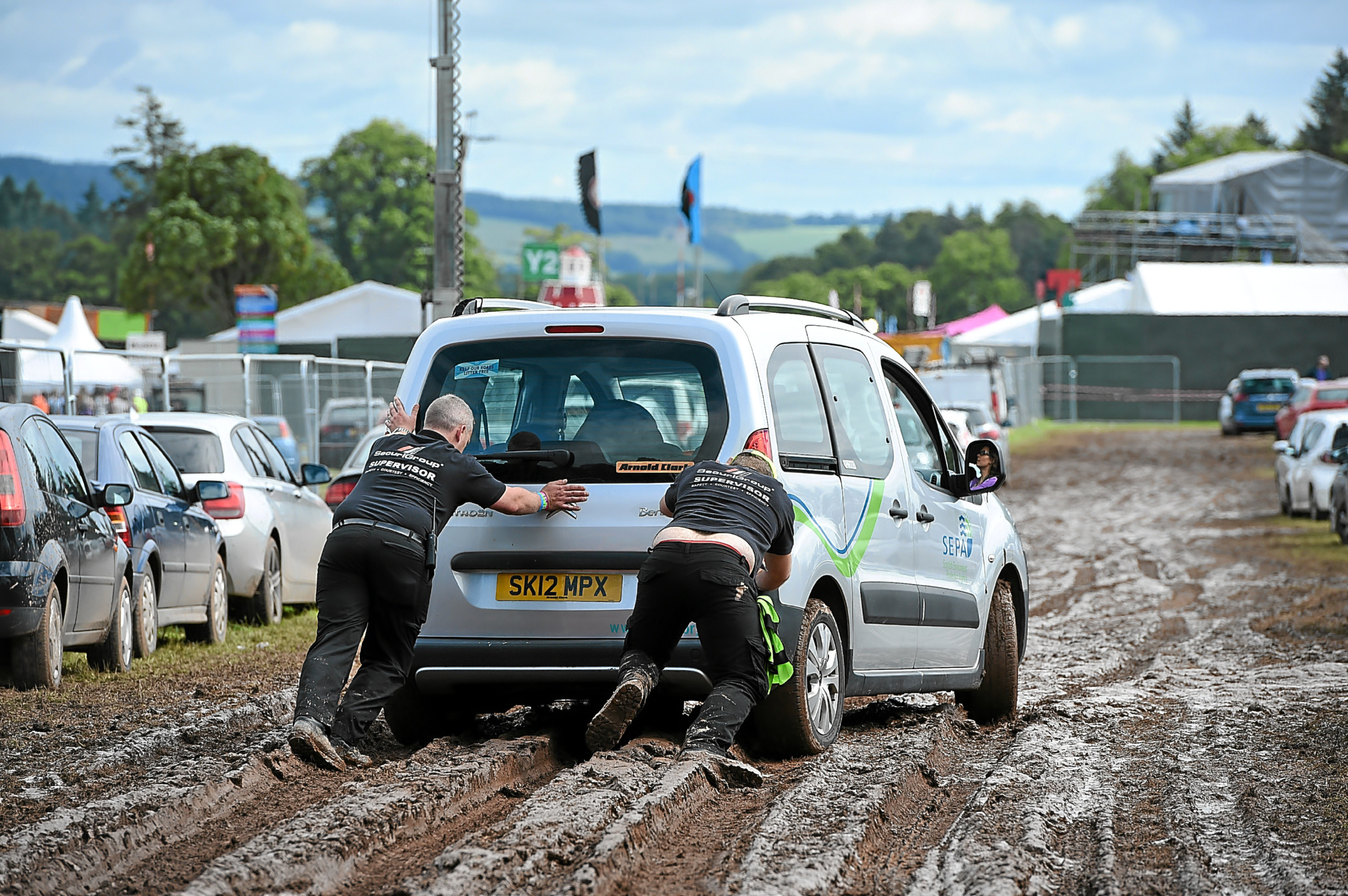 Cars struggle in the mud at last years T in the Park at Strathallan, where there was traffic chaos during the festival.