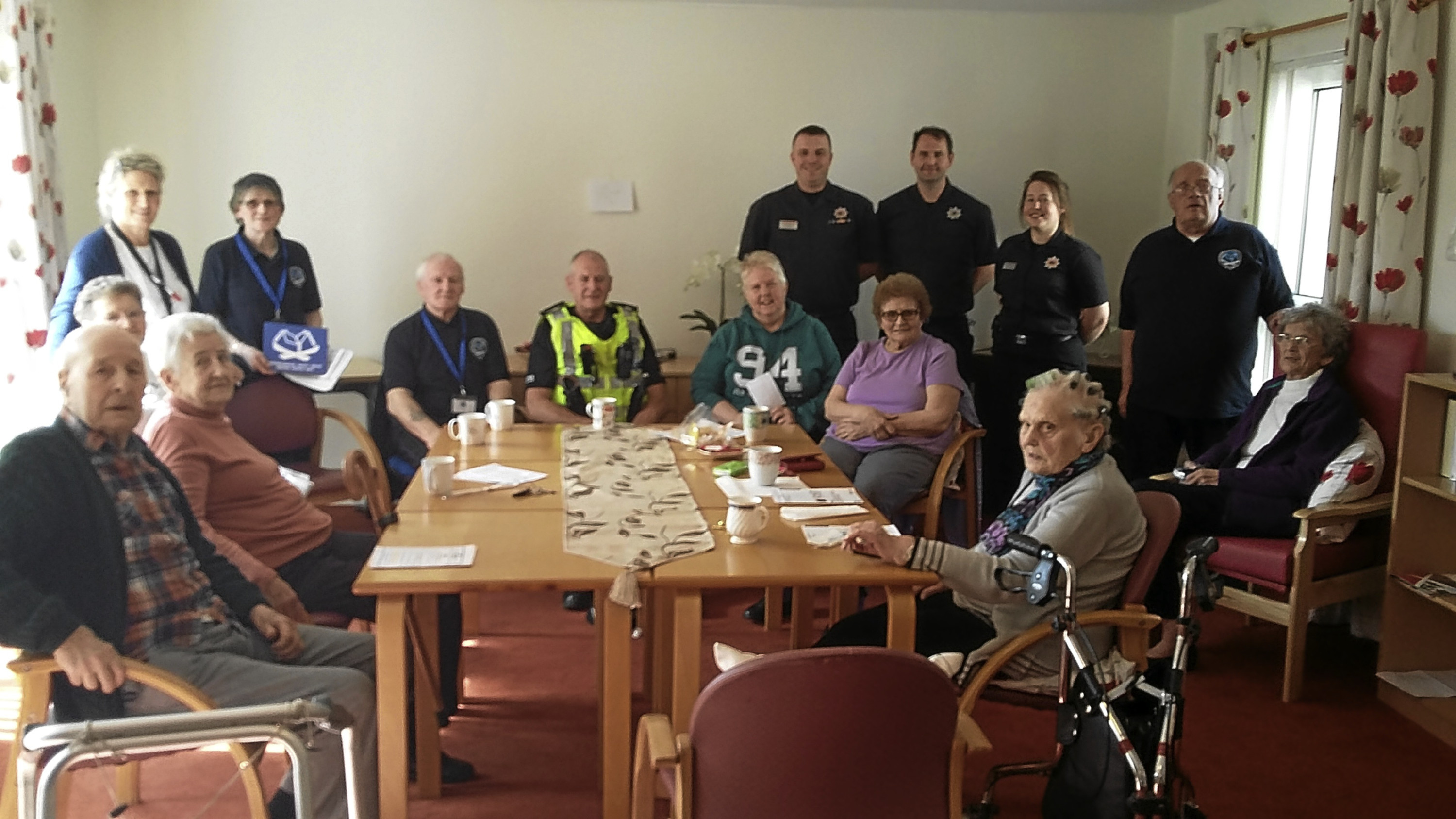 Residents of Burgh House in Leslie were given free home safety lessons by the Scottish Fire and Rescue Service and Police Scotland. Photo shows the fire service's Red Watch Glenrothes and Glenrothes area neighbourhood safety group with residents.