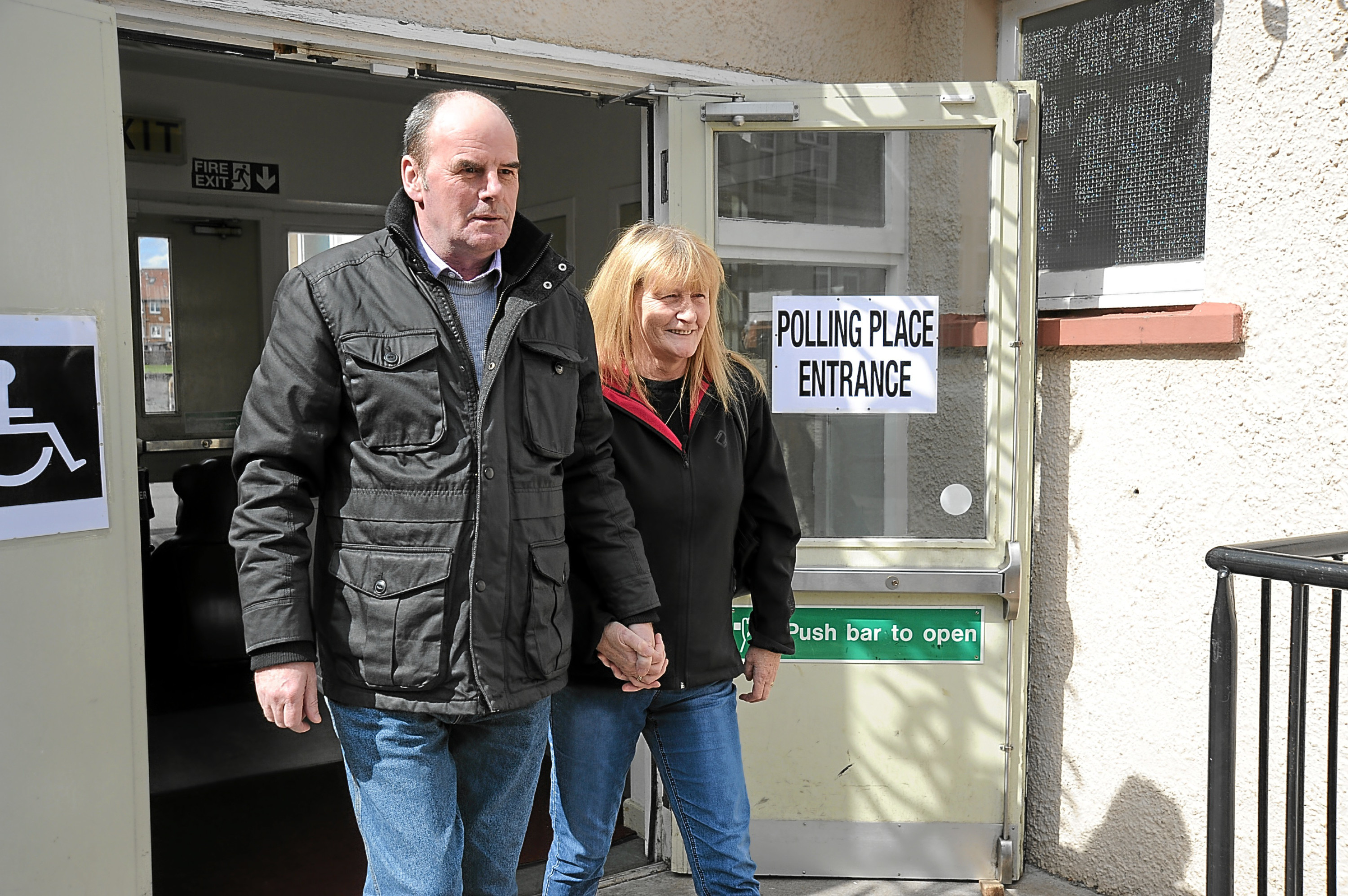 Voters exit the polling station at Denbeath Primary School in Buckhaven.