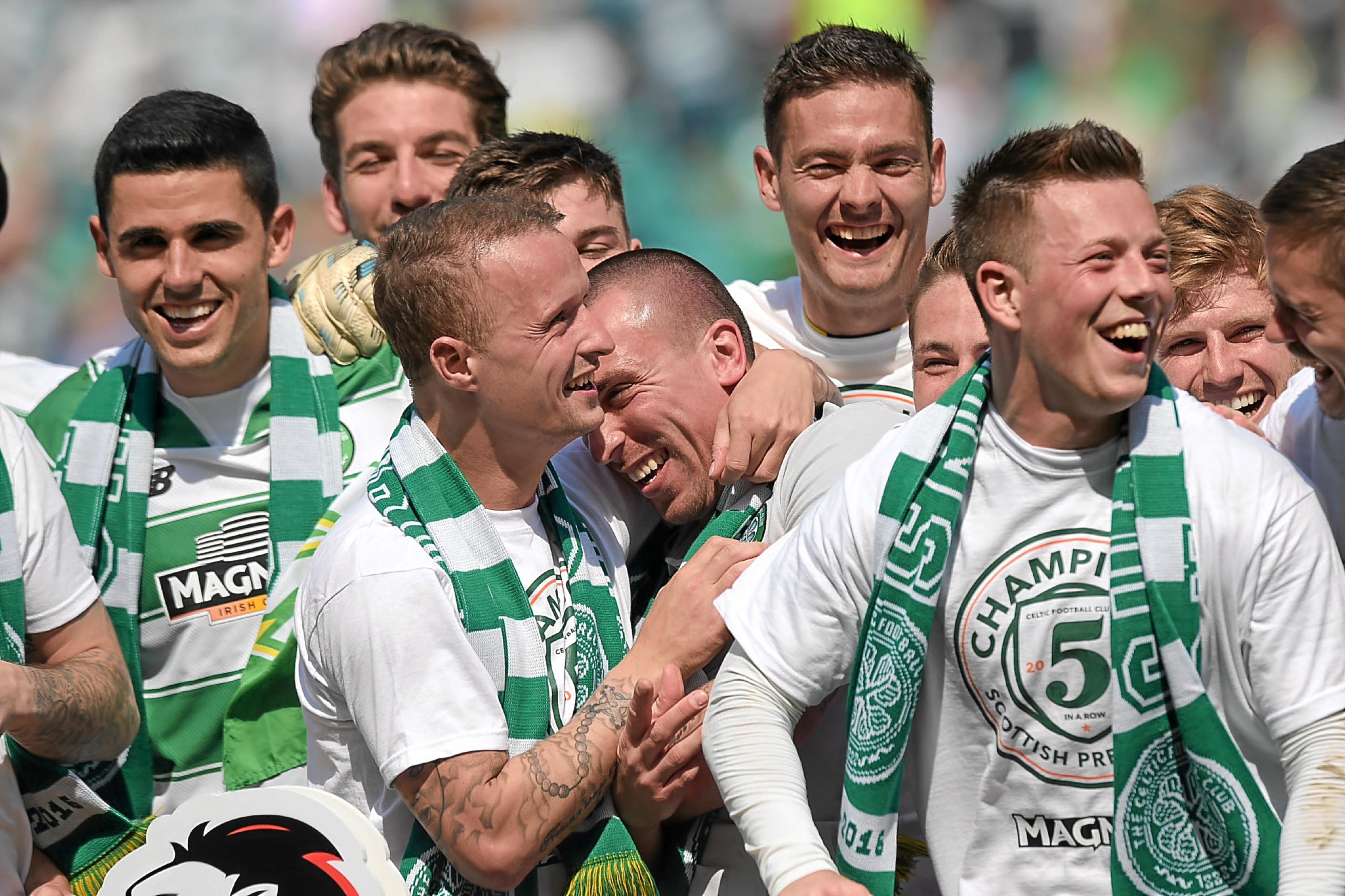 Celtic's Leigh Griffiths and Scott Brown celebrate winning the Ladbrokes Premiership.
