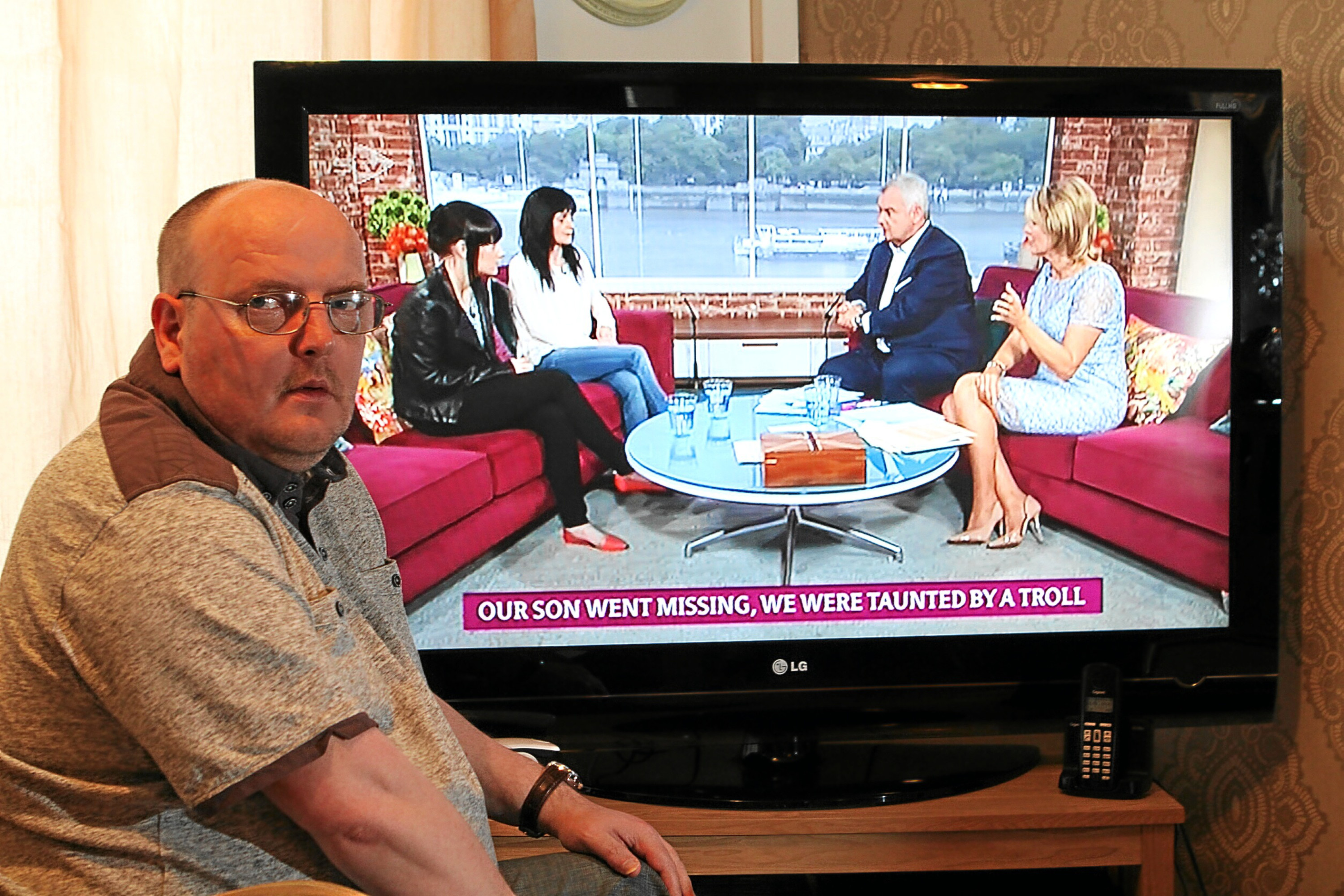 Allan Bryant, with his partner Marie Degan and daughter Amy Bryant on 'This Morning' on the television.