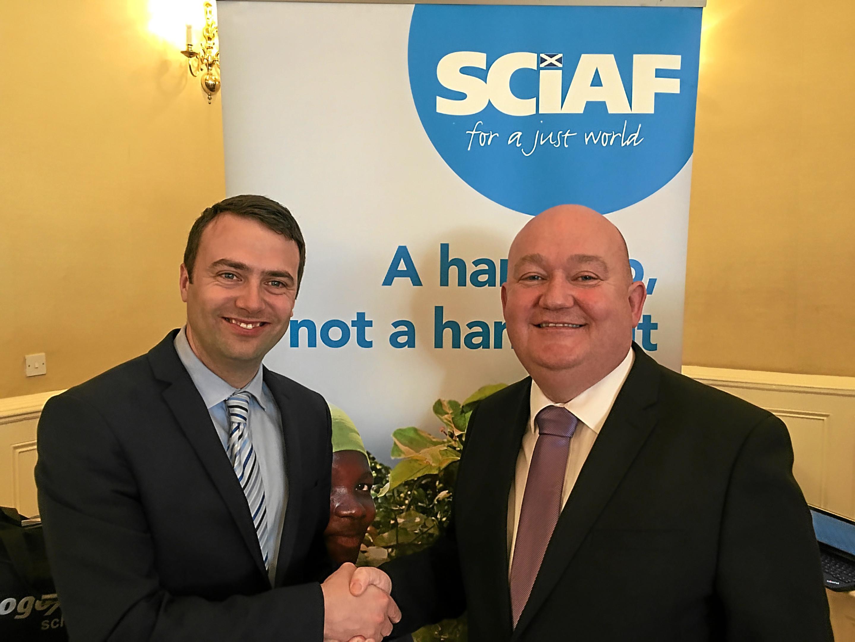 Mark Booker (left, Schools officer, SCIAF) and Seán Hagney (right, headteacher St John's RC Academy)