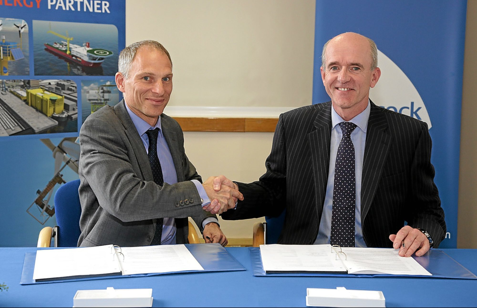 Duncan Clark (left), Programme Director for Hornsea and Ian Donnelly (right), Managing Director of Babcocks energy and marine business sign supply contract for reactive compensation station.