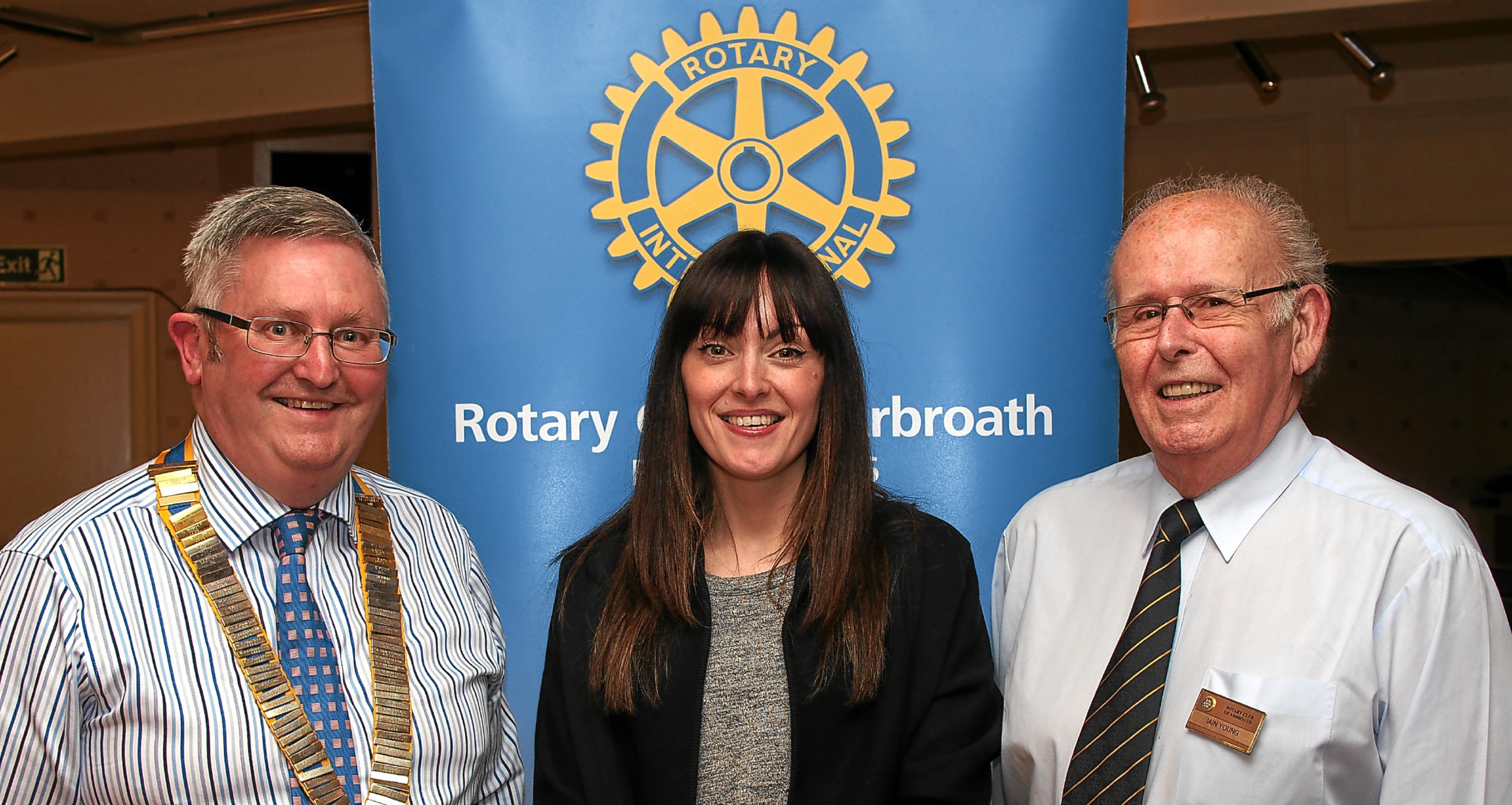 Rotary members David Miller and Iain Young with (middle) Sam Edmond, V&A development manager