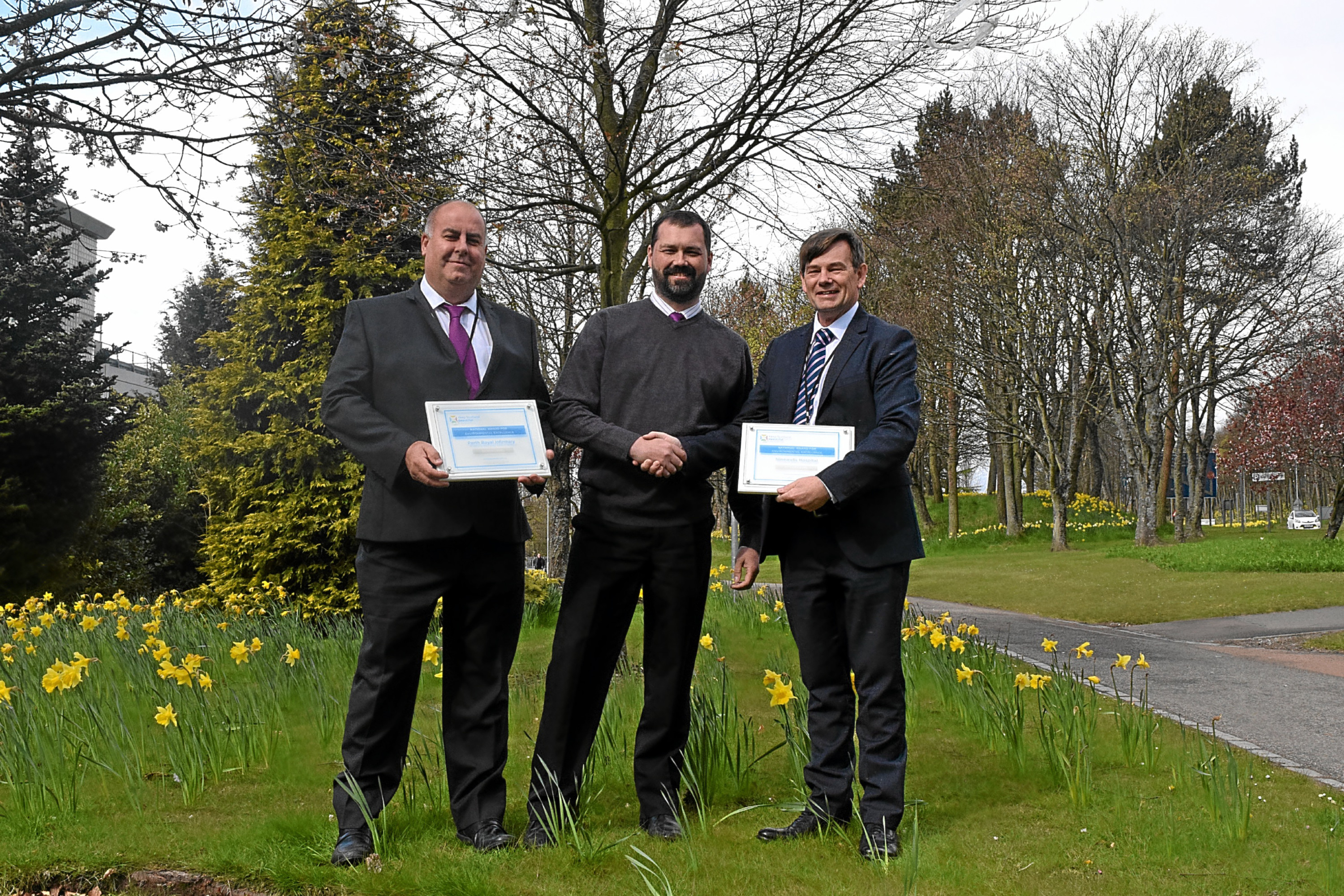 Photo of Robert Harvie, estates manager with NHS Tayside, Colin Hegarty, local environmental quality coordinator with Keep Scotland Beautiful and Malcolm Ross, grounds maintenance manager with NHS Tayside.