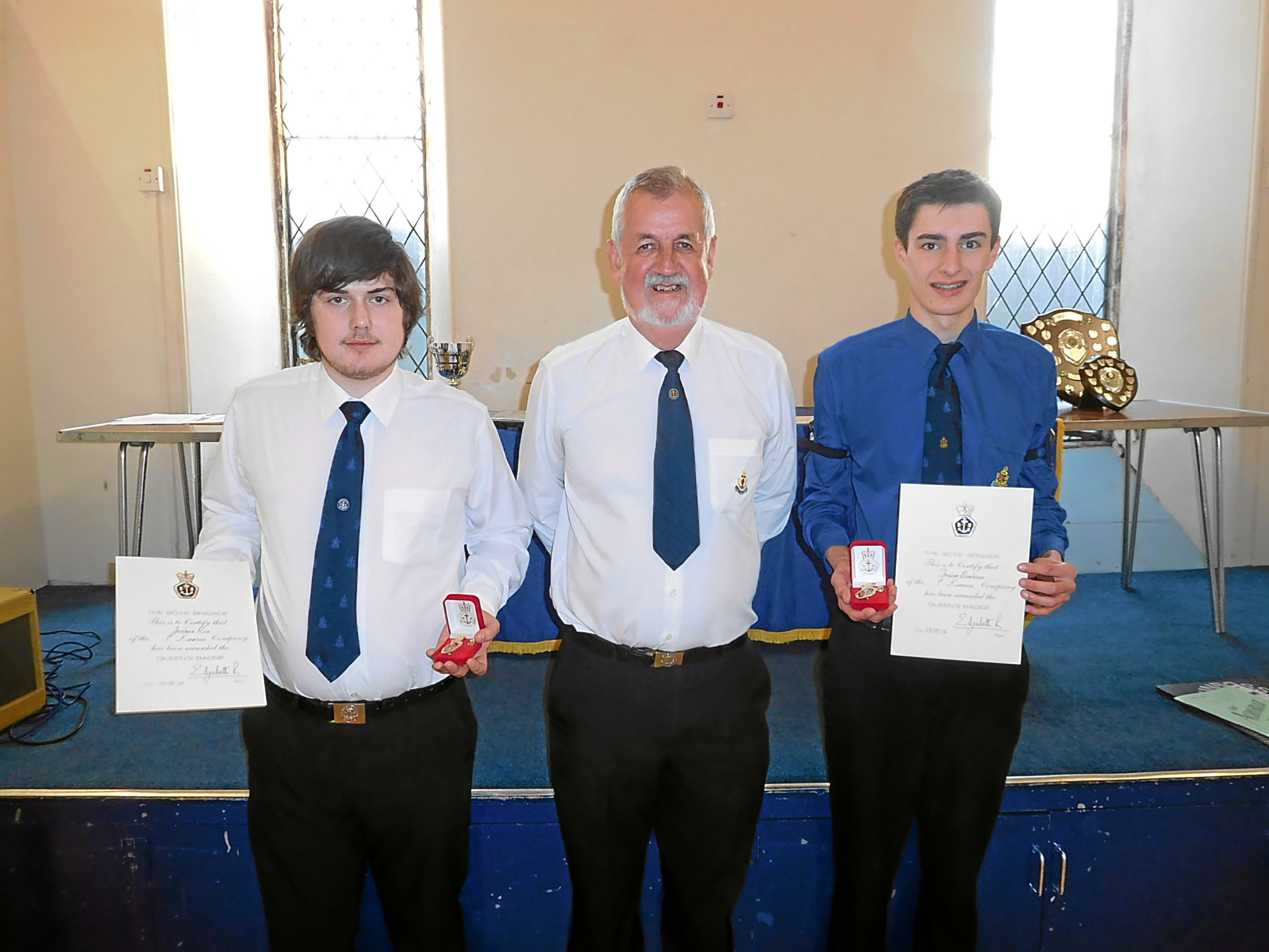 1st Kinross BB held a presentation where two Queen's Badges were among the awards presented - left to right Joshua Roe, company captain David Munro and Fraser Barbour.