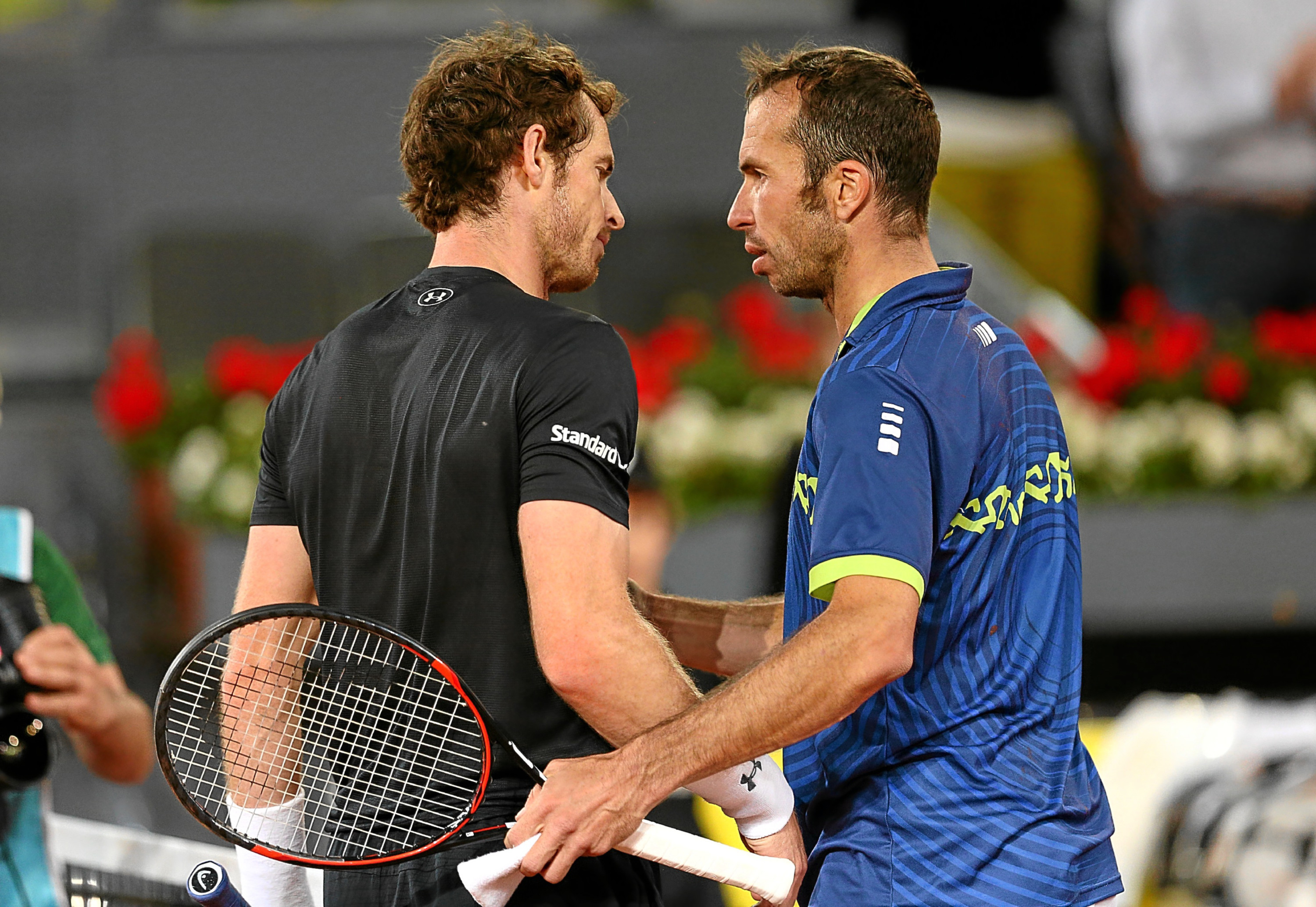 Andy Murray shakes hands at the net after his three set victory against Radek Stepanek at the Madrid Open.
