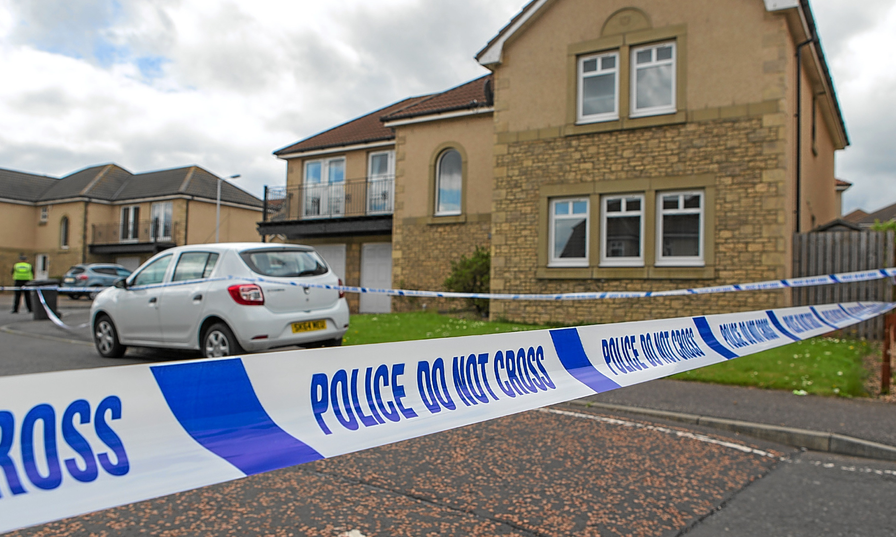 Police cordoned off the house after the gun incident.