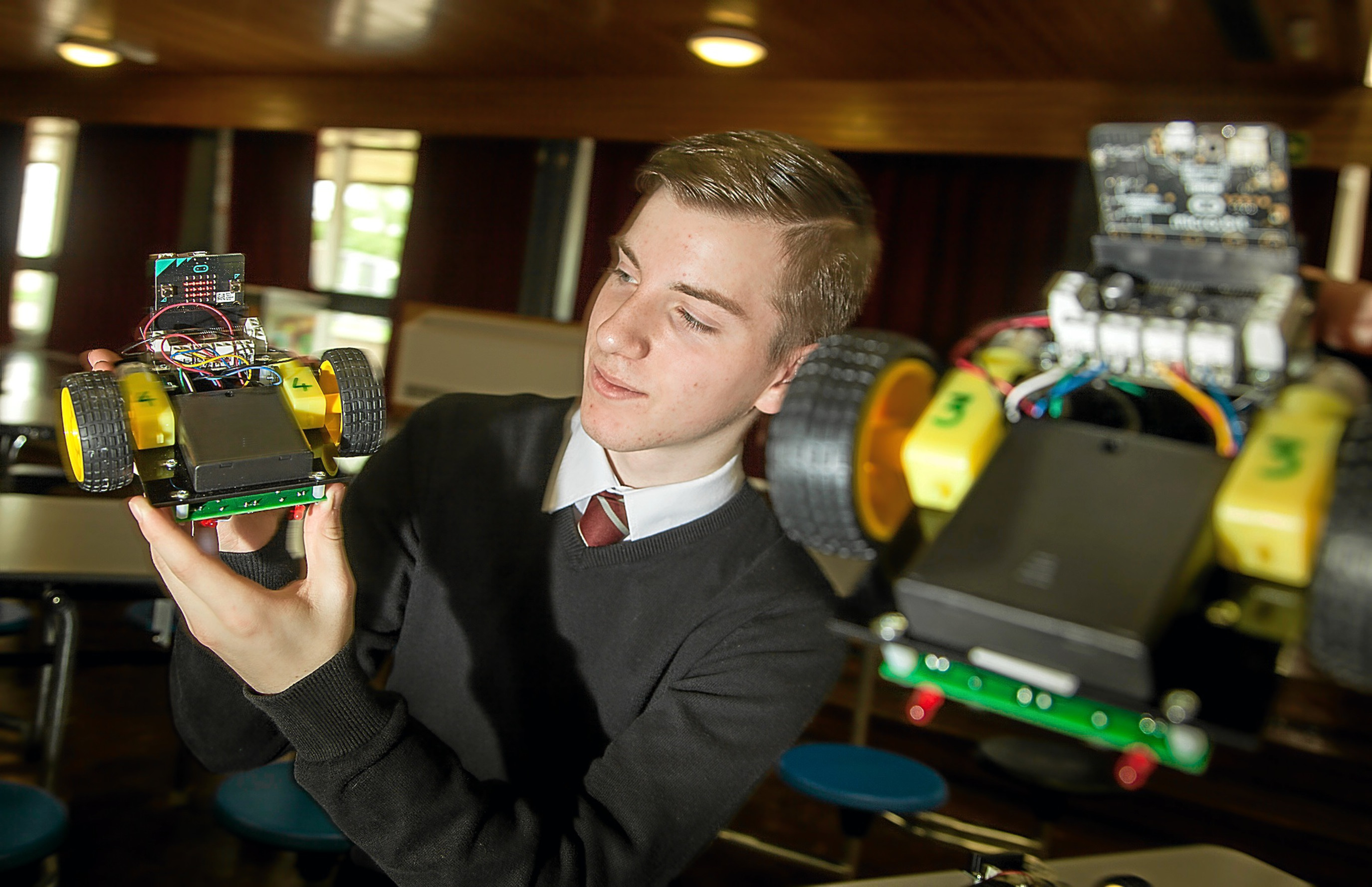 Sixth year pupil Fraser Steele with a microbit-controlled robot.