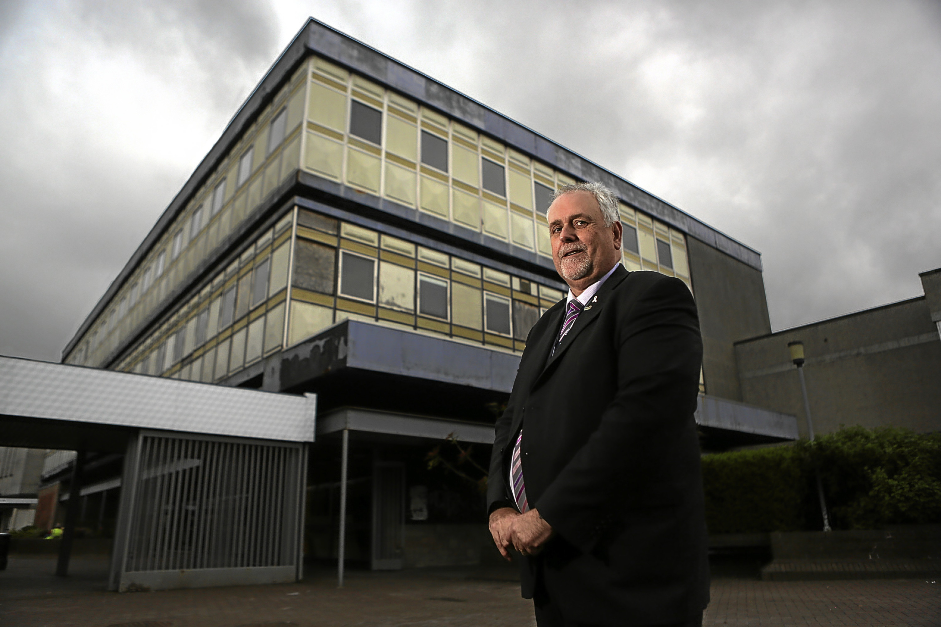 Kris Miller, Courier, 24/05/16. Cllr Bill Brown outside the former co-op building in the Kingdom Shopping centre, Glenrothes. The building is marked to be demolished as part of the town centre regeneration