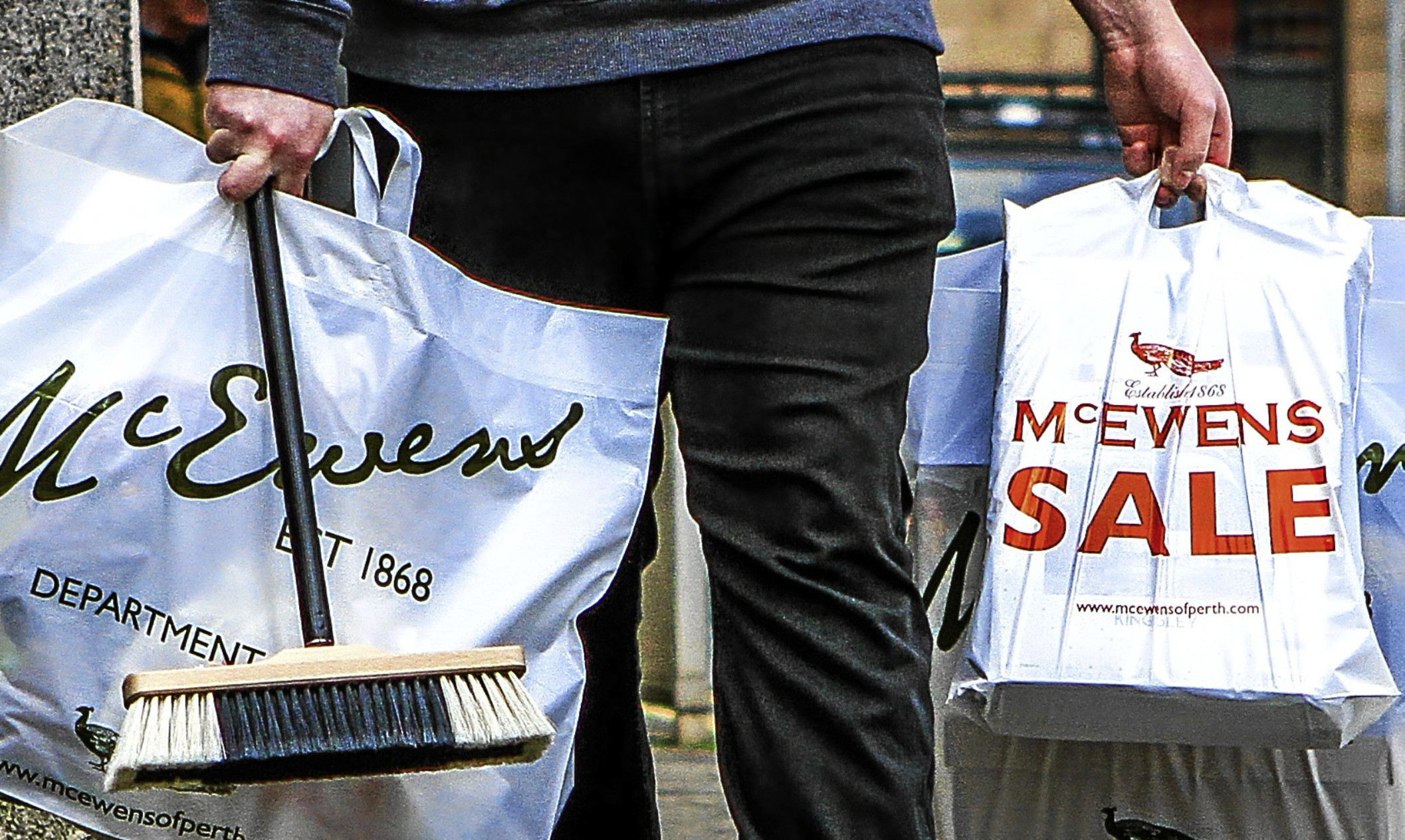 Shopper with sales bags from McEwens of Perth.