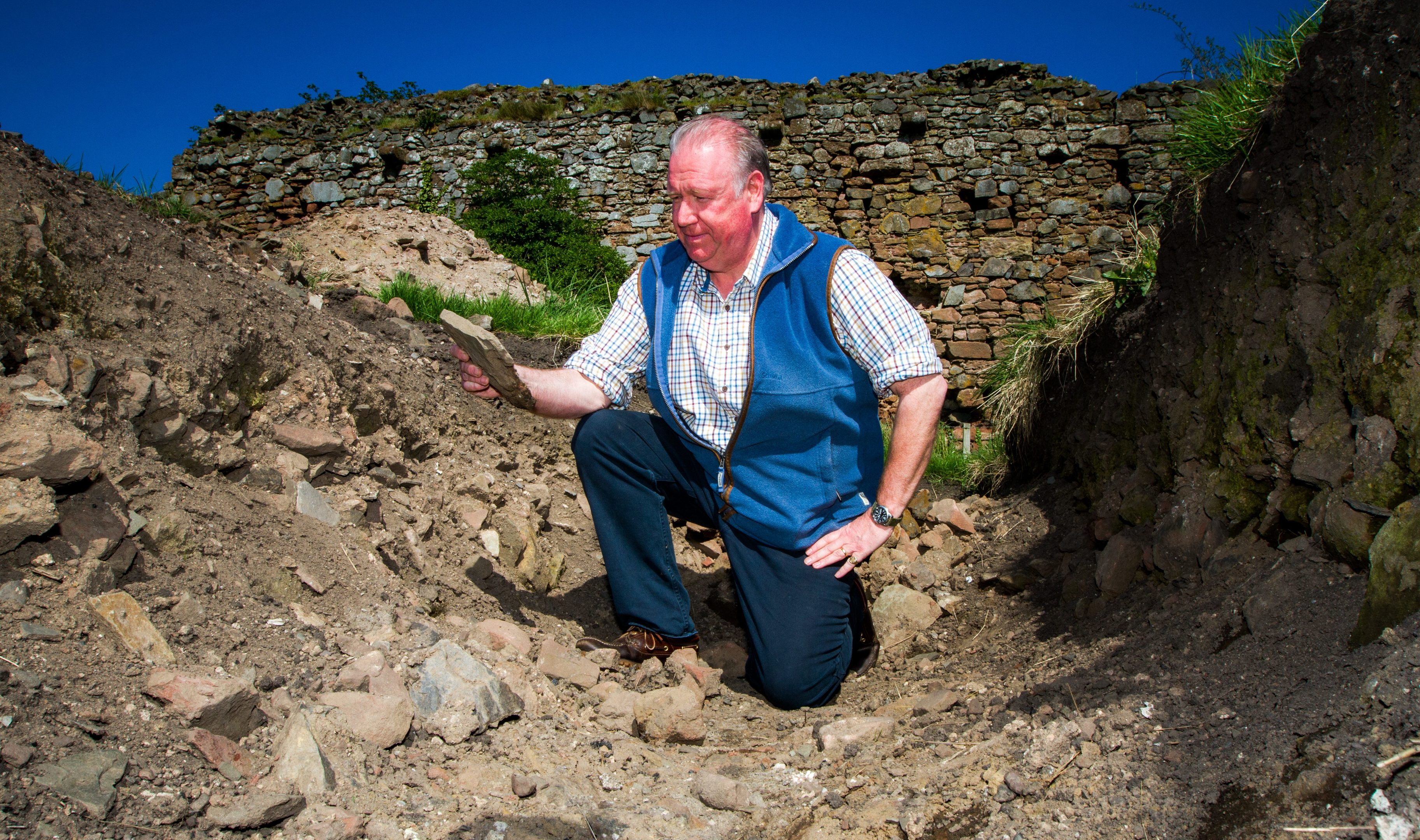 Drew McKenzie Smith in one of the archaeological trenches at the Lindores Abbey paddock area.