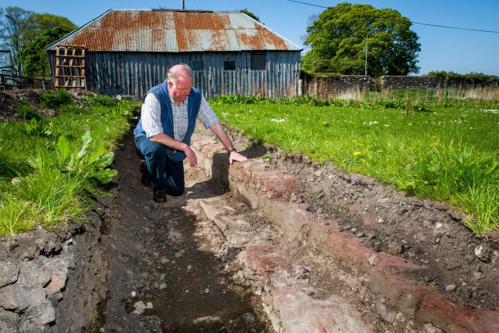 Drew McKenzie Smith examines the foundations recently discovered by archaeologists working at the distillery site