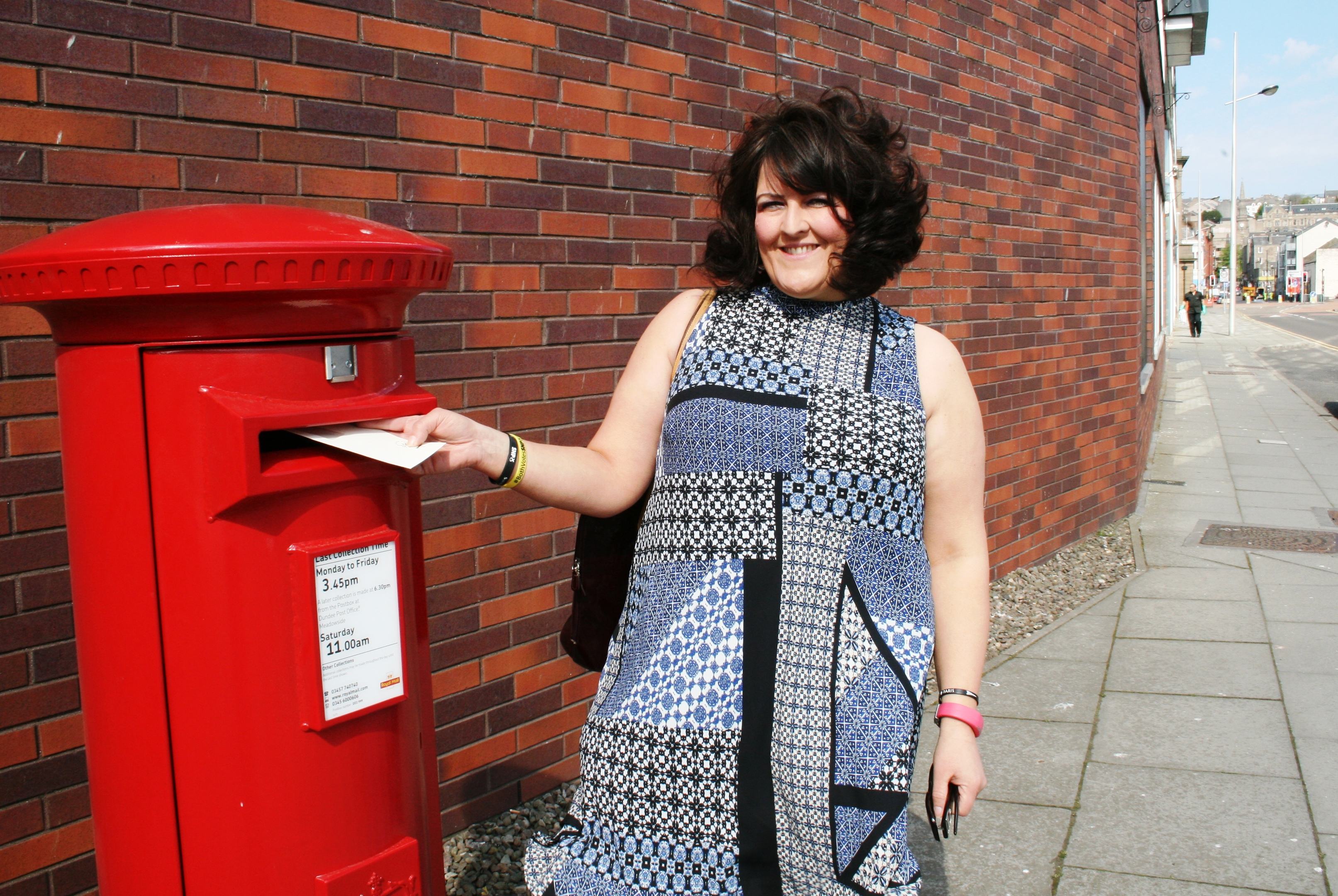 Councillor Lynne Short posts the first letter at the new City Quay post box.