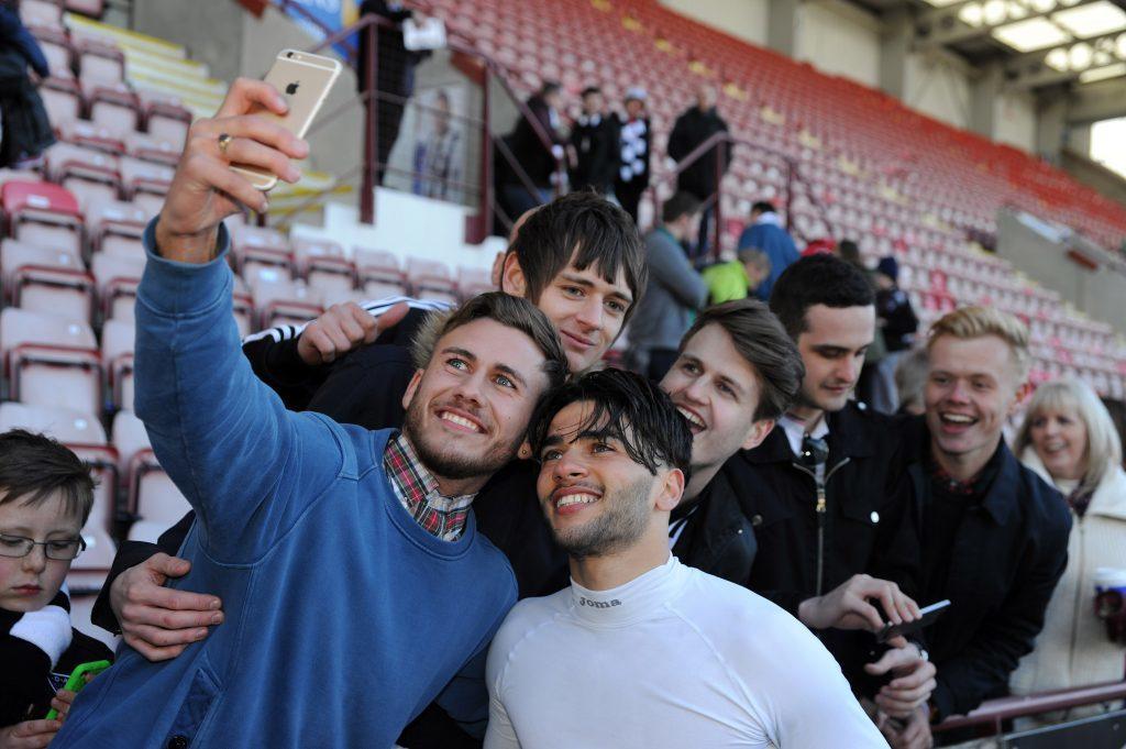 Faissal El Bakhtaoui celebrates with fans.