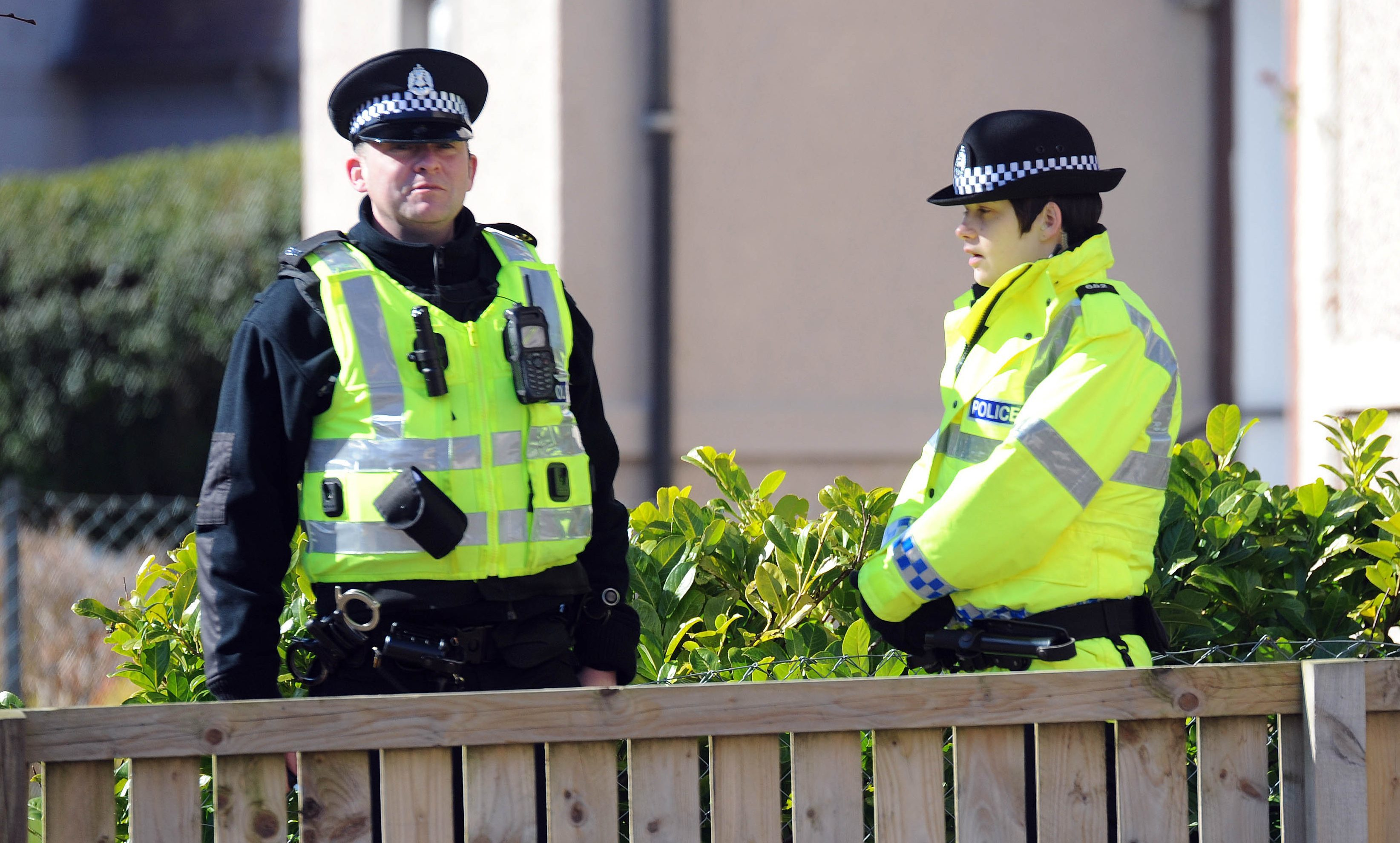 Police outside the house in Thornton the day after the body of Liam Fee was found in March 2014.