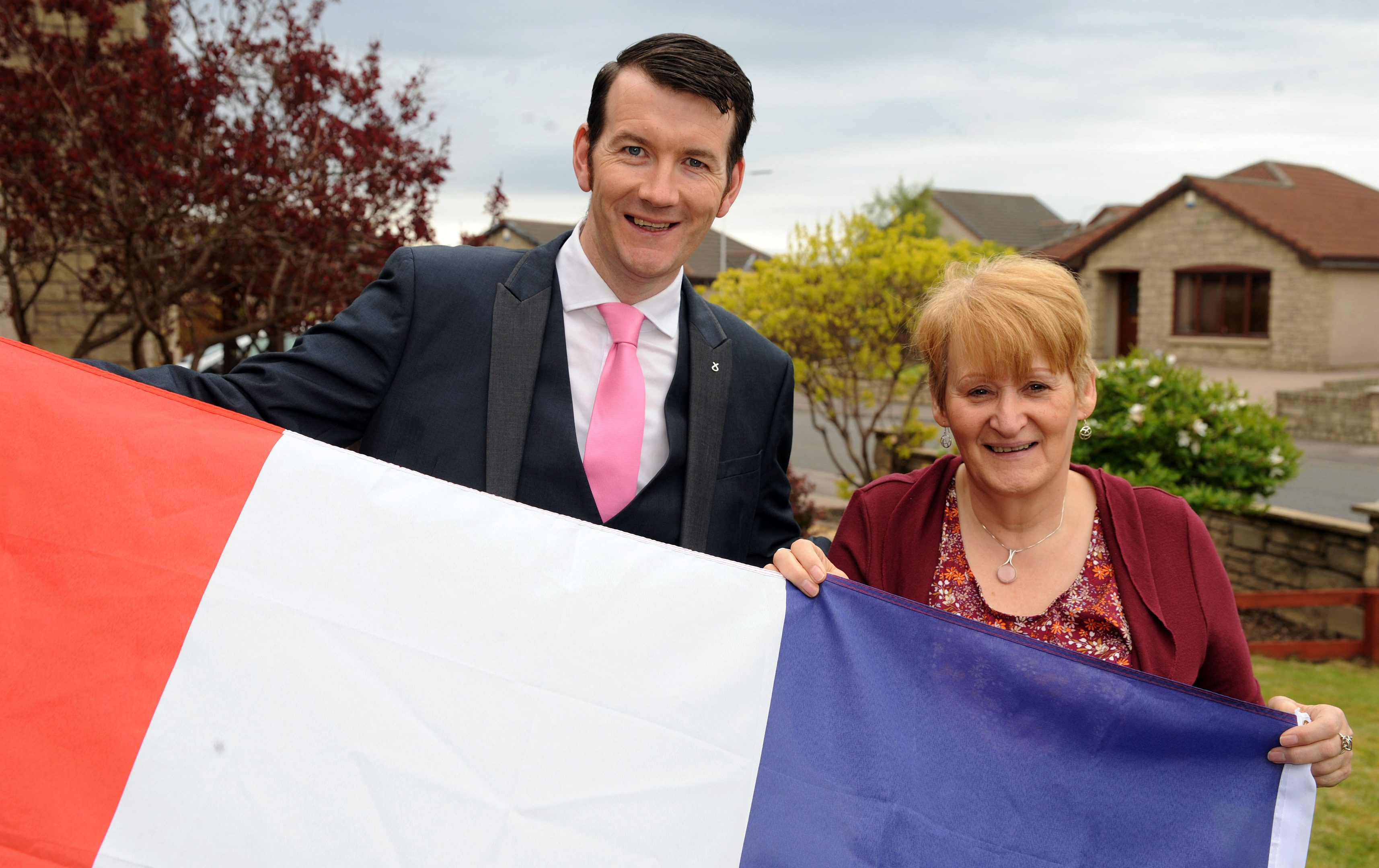 Councillor Alistair Hunter and Linda Judge from Leven Town Twinning Association with the French flag.