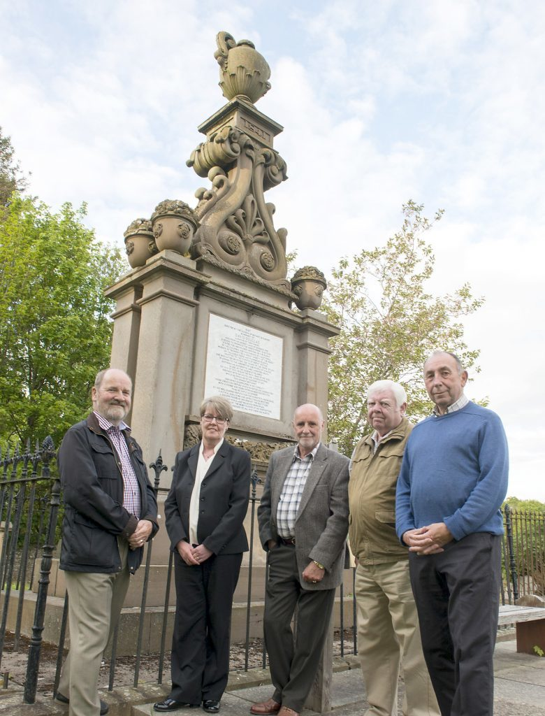 Members of The Scone and District Historical Society with the memorial.