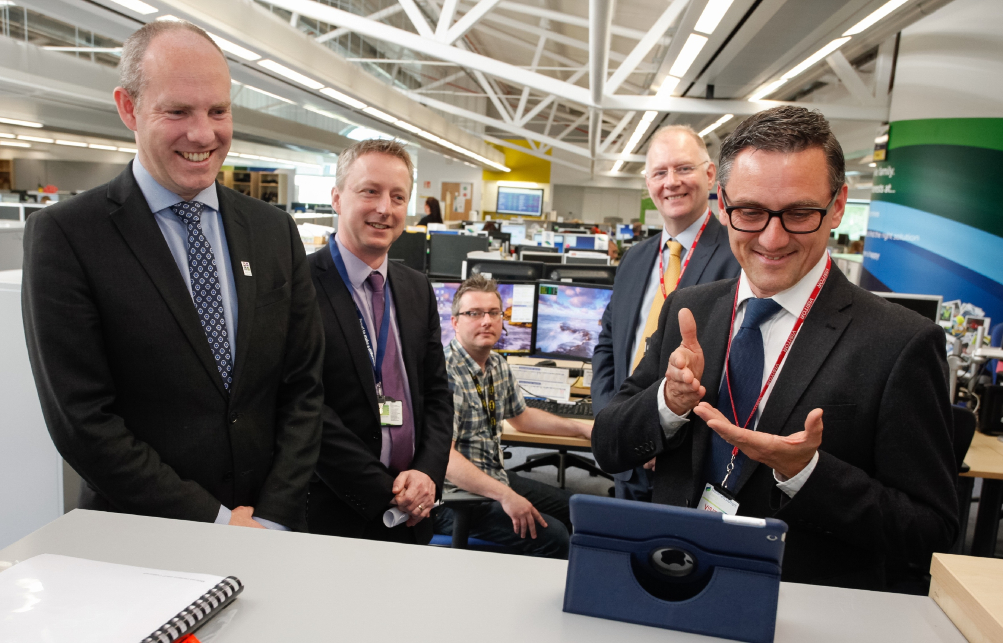 Executives look on as the first video sign call is made from an SSE call centre