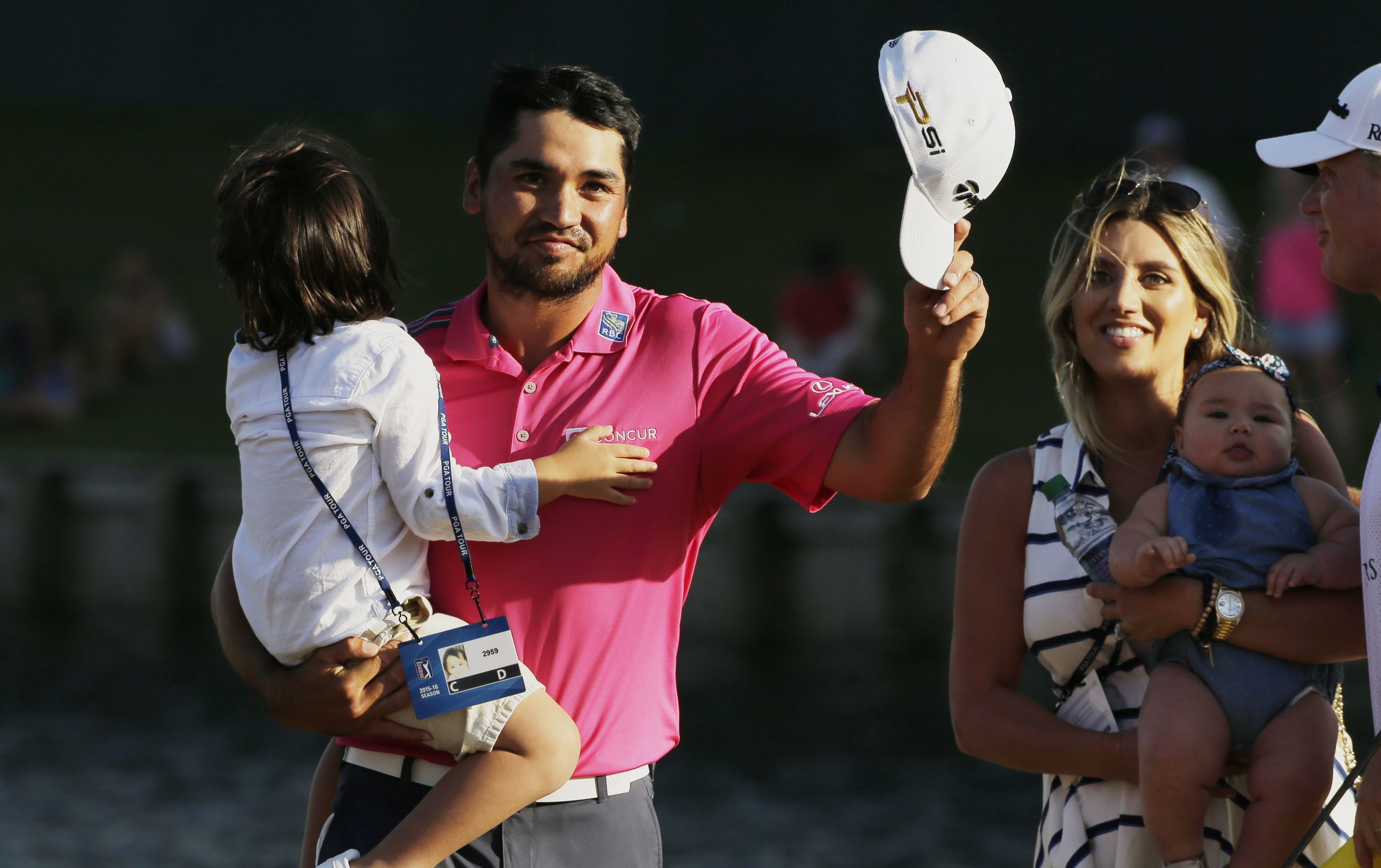 Jason Day celebrates his Players win with his family.