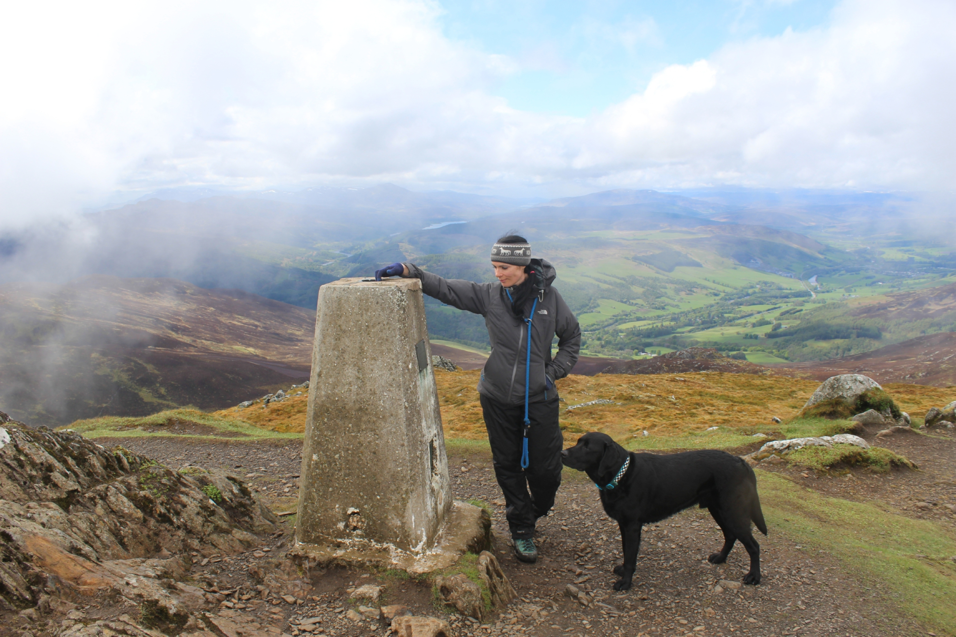 Gayle and her dog Toby at the trig pillar on Ben Vrackie.