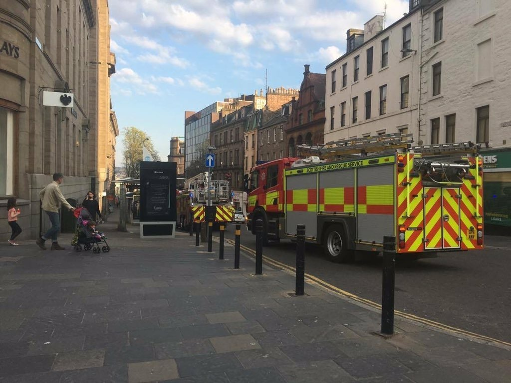 The fire appliances pictured in the city centre tonight.