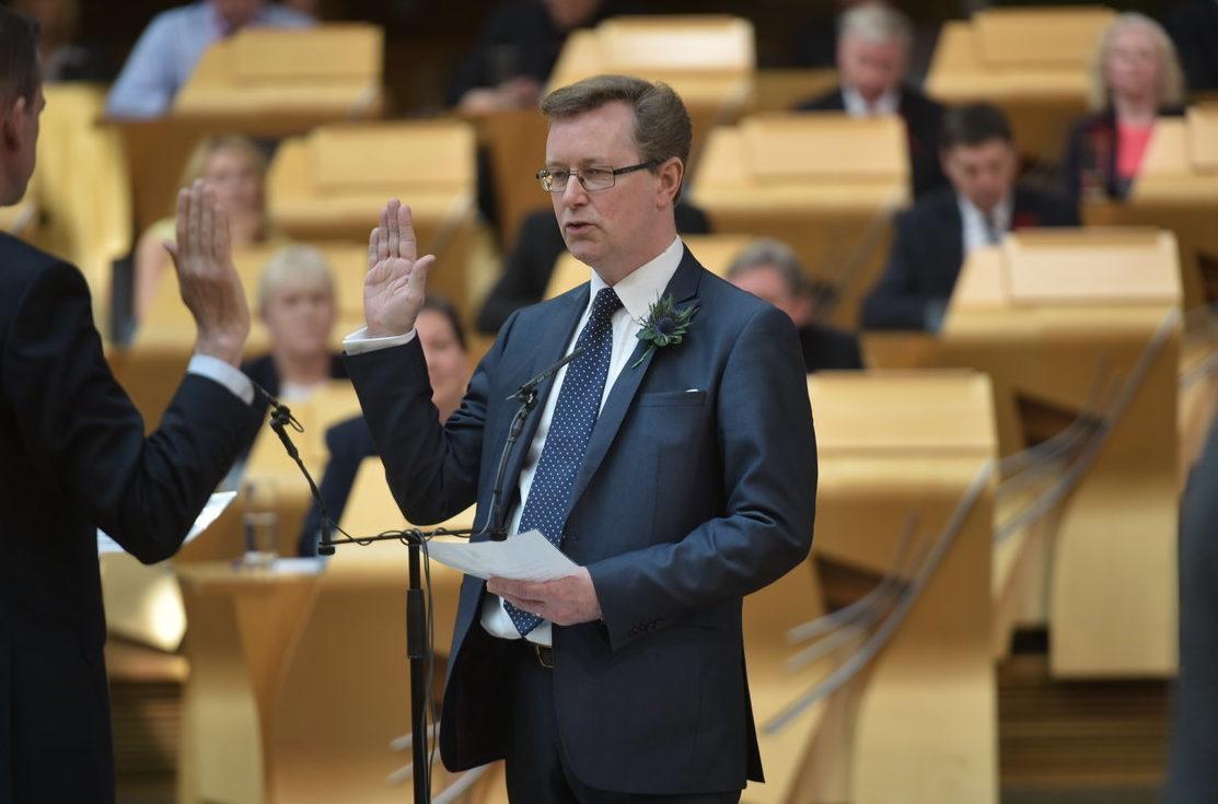 Alexander Stewart being sworn in as an MSP.