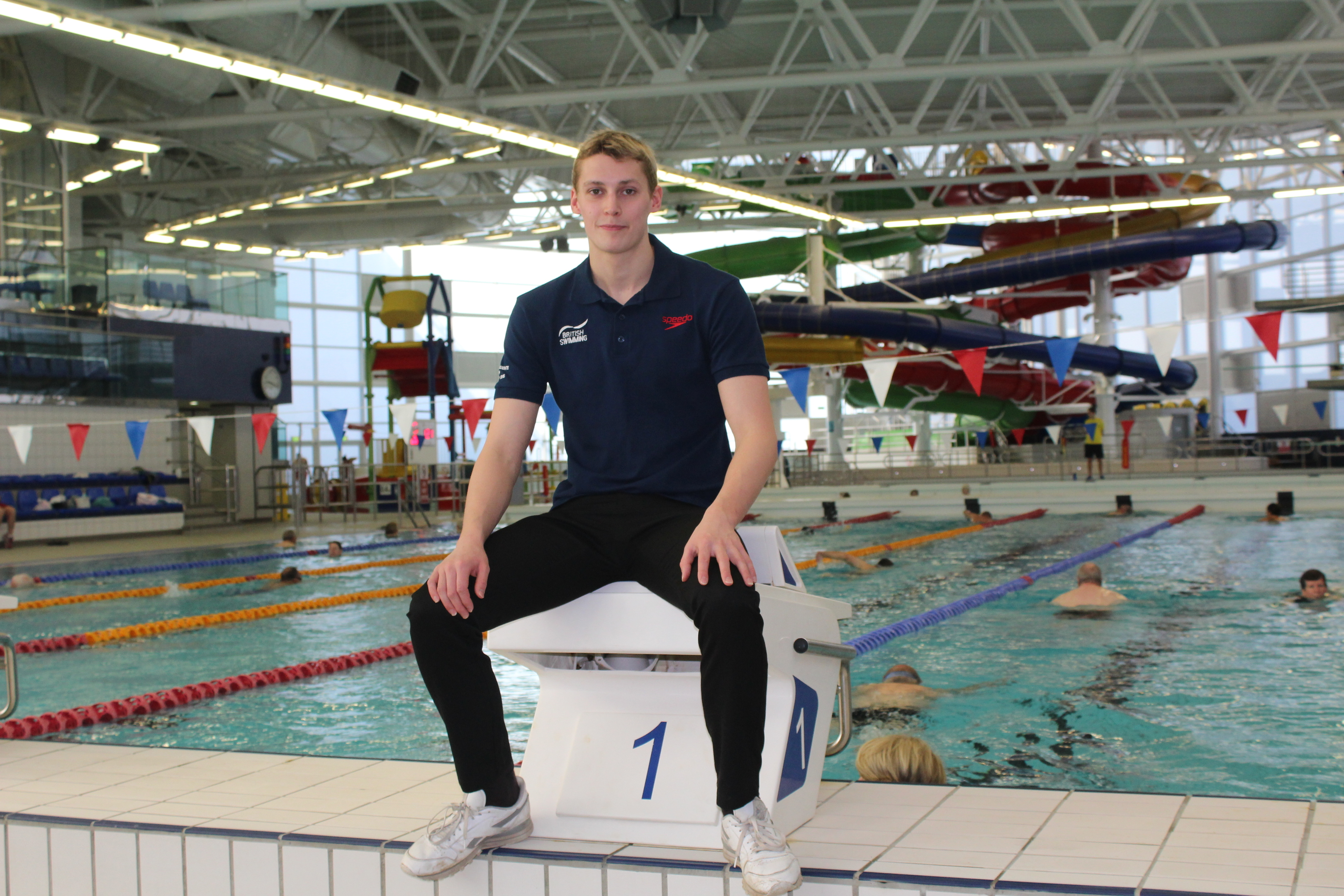 Stephen Milne sitting by the training pool at Olympia