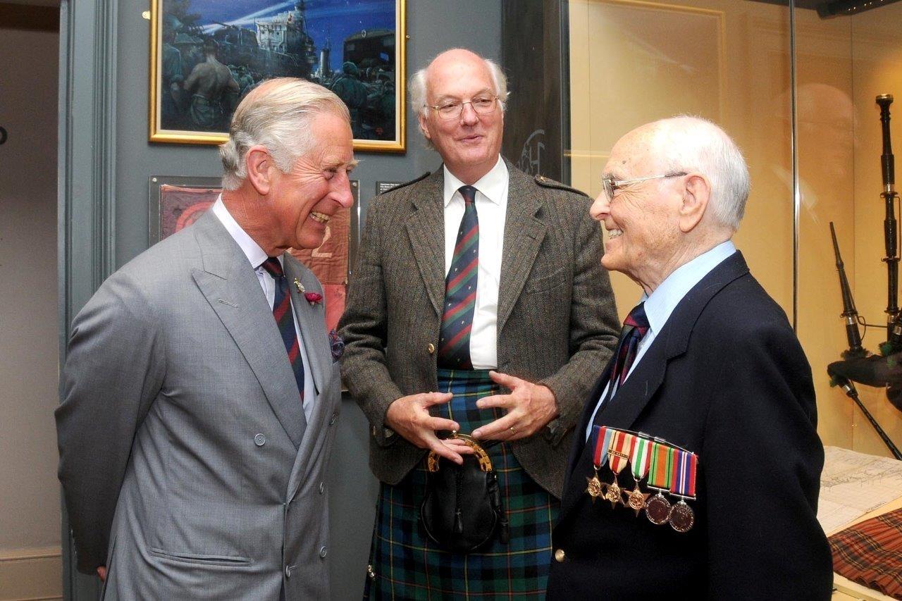 Jim Simpson meeting Prince Charles.