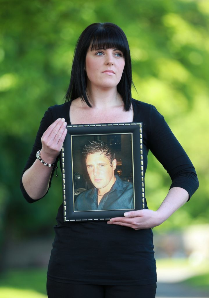 Lisa McLean with a photo of her brother Barry