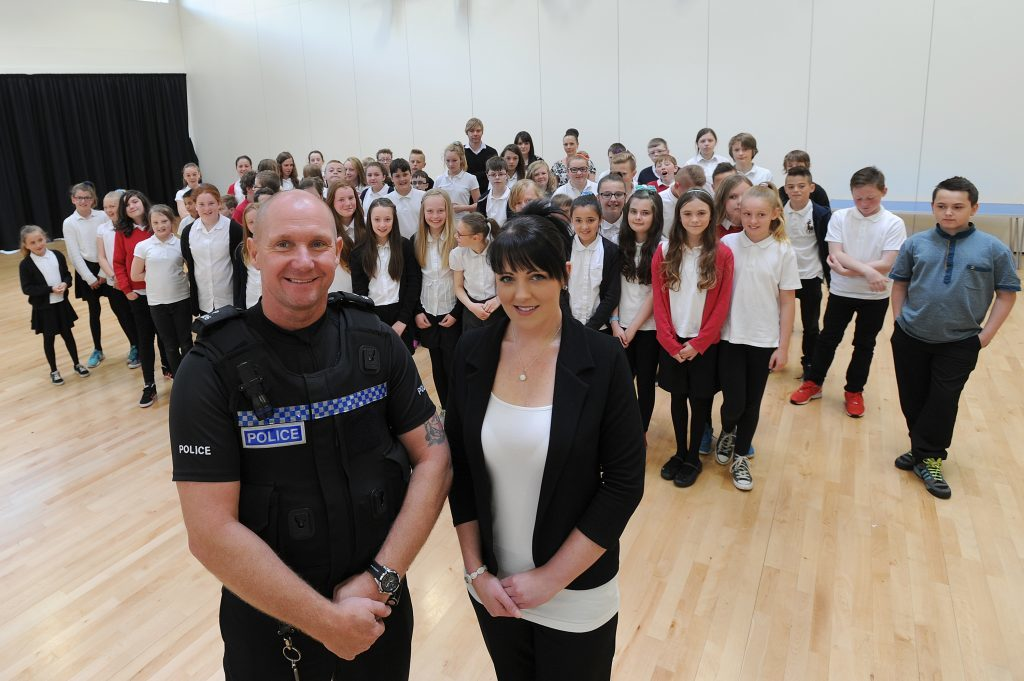Lisa McLean, sister of Barry McLean, with PC Ross Masterton, giving an anti-knife crime talk to pupils at Burntisland Primary.