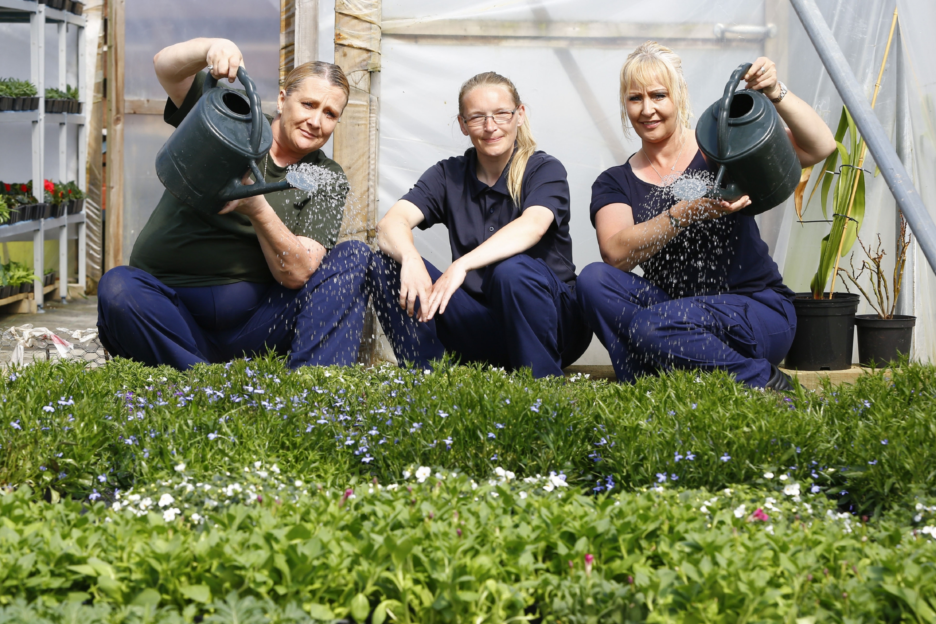 Prisoners Wendy, Dawn and Hilda water plants at Cornton Vale.