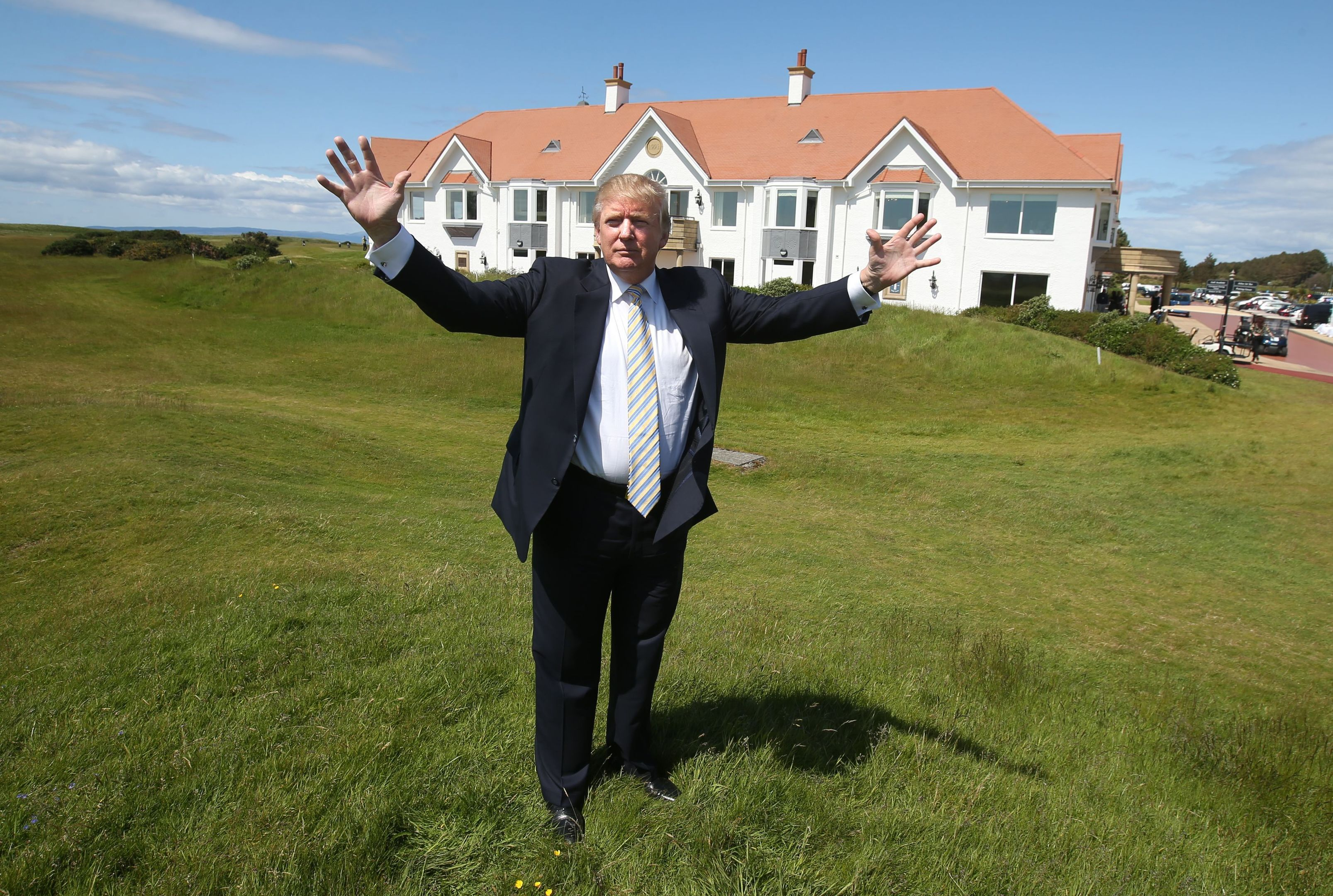 Donald Trump poses after unveiling the multi-million pound refurbishment of the Trump Turnberry clubhouse.