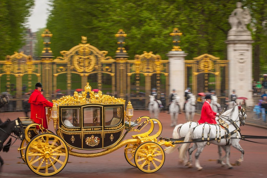 RETRANSMITTED CORRECTING NAME OF COACH The Diamond Jubilee state coach transporting Queen Elizabeth II passes Canada Gate as she leaves Buckingham Palace, London, ahead of the State Opening of Parliament. PRESS ASSOCIATION Photo. Picture date: Wednesday May 18, 2016. See PA story POLITICS Speech. Photo credit should read: Dominic Lipinski/PA Wire