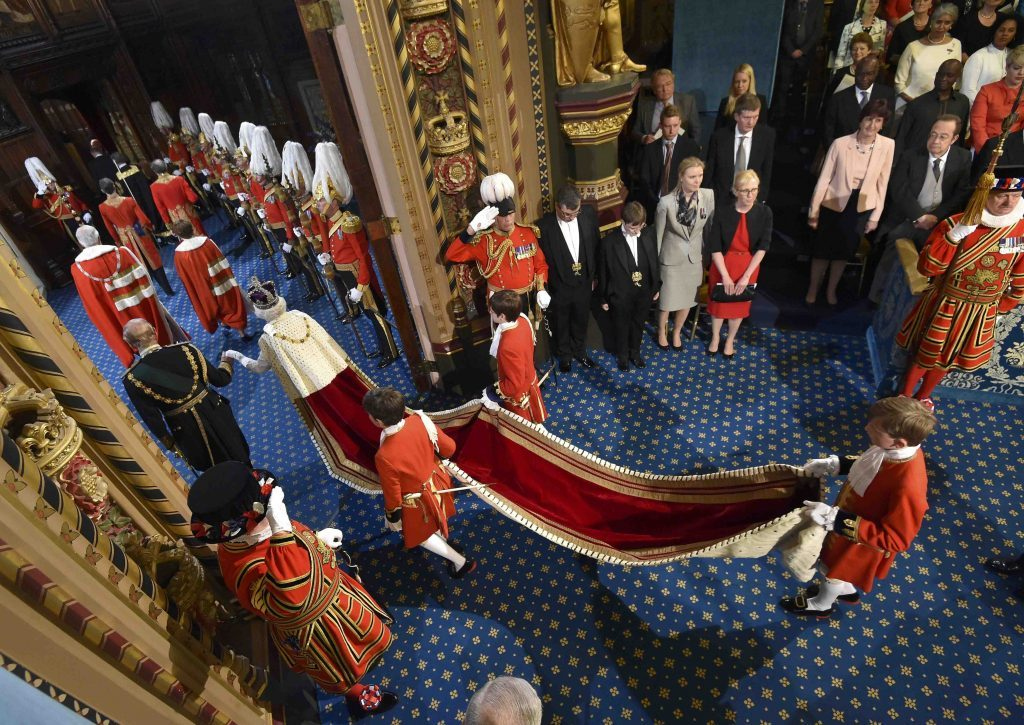 Queen Elizabeth II and the Duke of Edinburgh proceed through the Royal Gallery ahead of the State Opening of Parliament, in the House of Lords at the Palace of Westminster in London. PRESS ASSOCIATION Photo. Picture date: Wednesday May 18, 2016. See PA story POLITICS Speech. Photo credit should read: Toby Melville/PA Wire