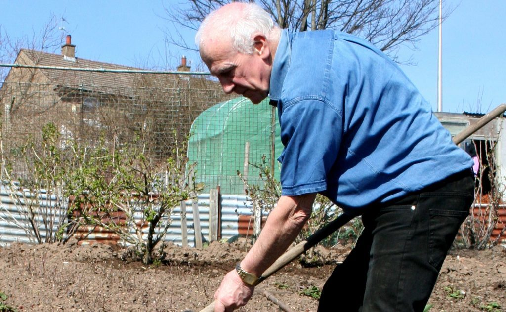 John Stoa at work in the garden