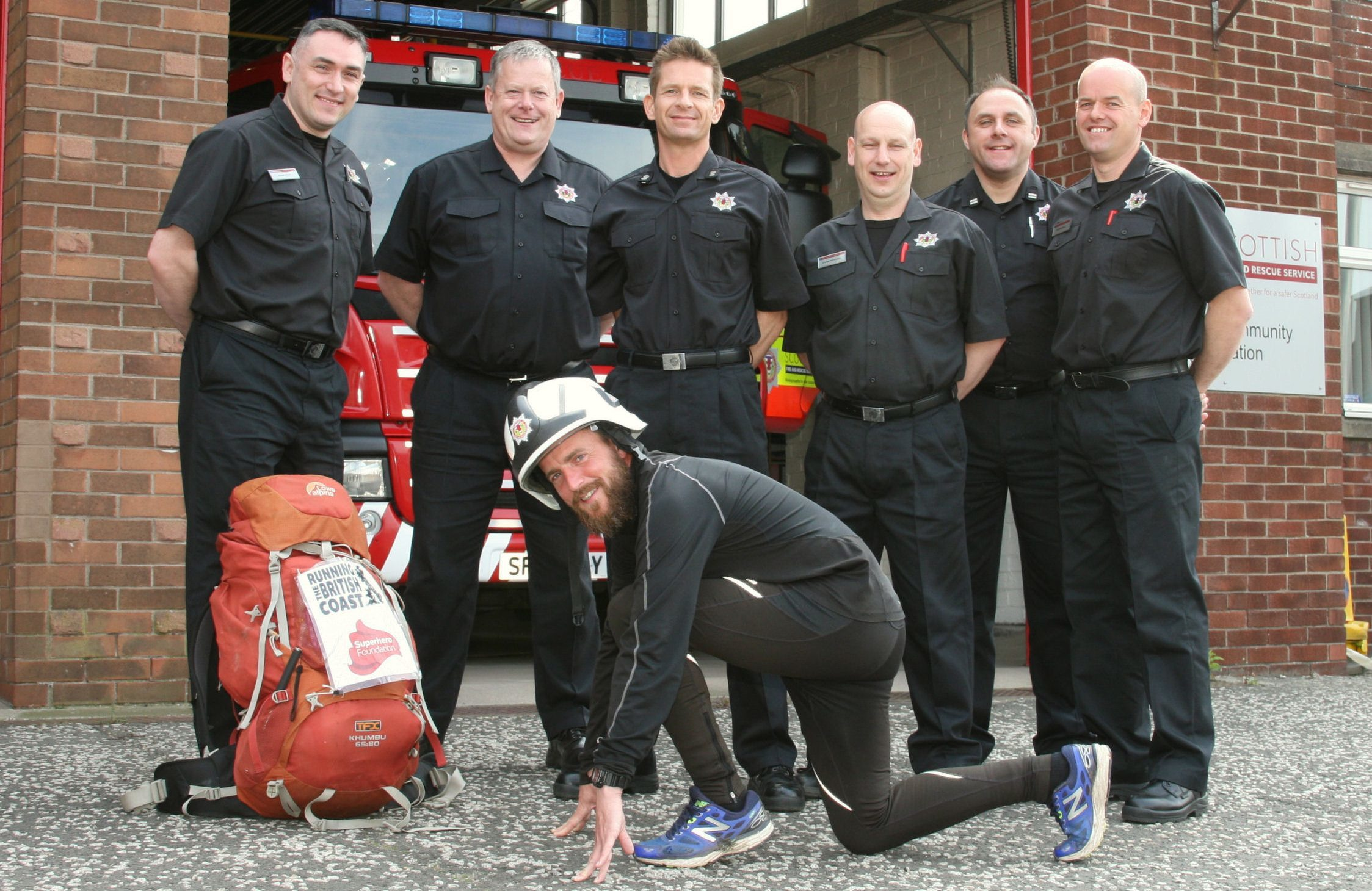 Wayne is pictured wearing a helmet with the firemen of Arbroath, from left — Mark Ross, Wayne Russell, Davie Duncan, Jim Stark, Mike Cossie, Gav Paterson, and Gav Coull.