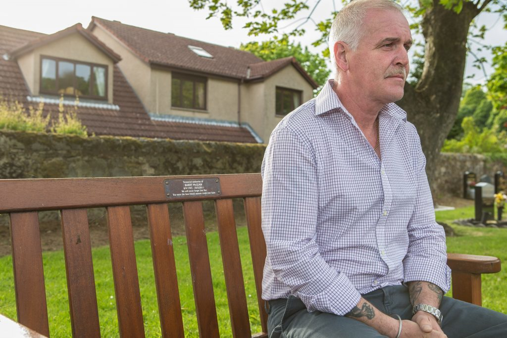 Alan McLean on the bench dedicated to Barry at Burntisland Cemetery