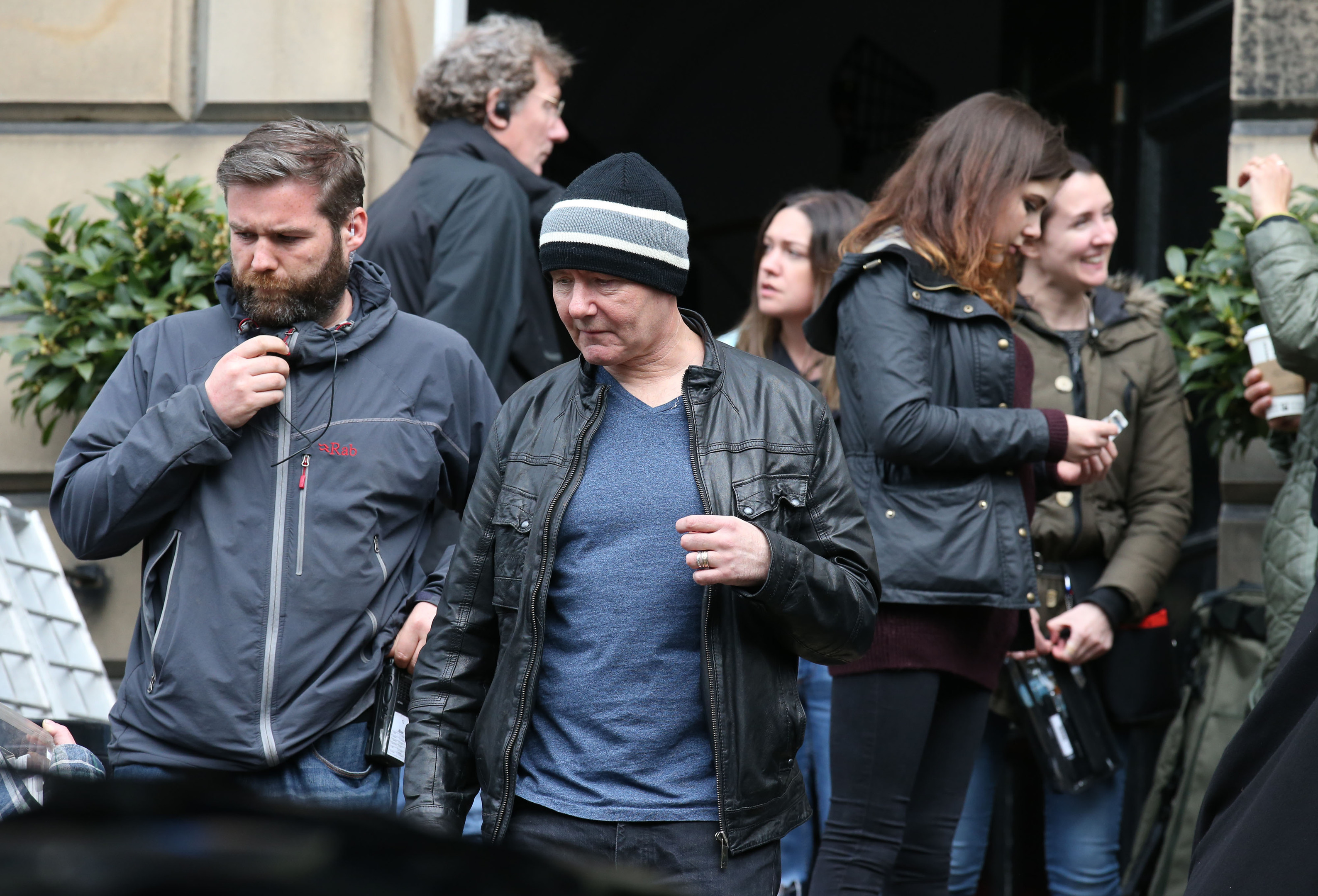 Irvine Welsh (centre) on the set of the film Trainspotting 2 which is currently being filmed in Edinburgh.