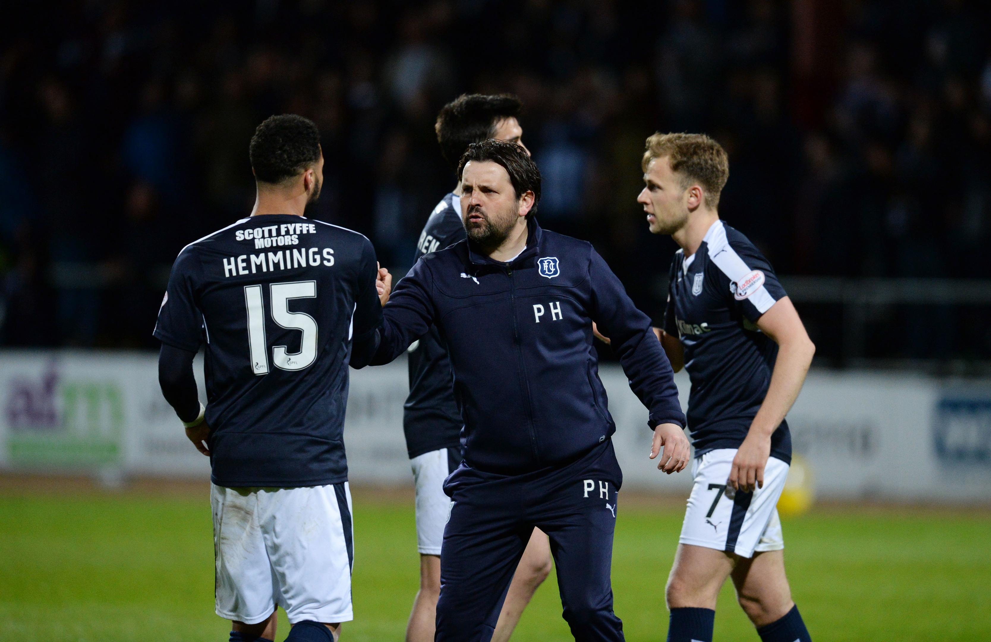 Dundee celebrate at full-time.