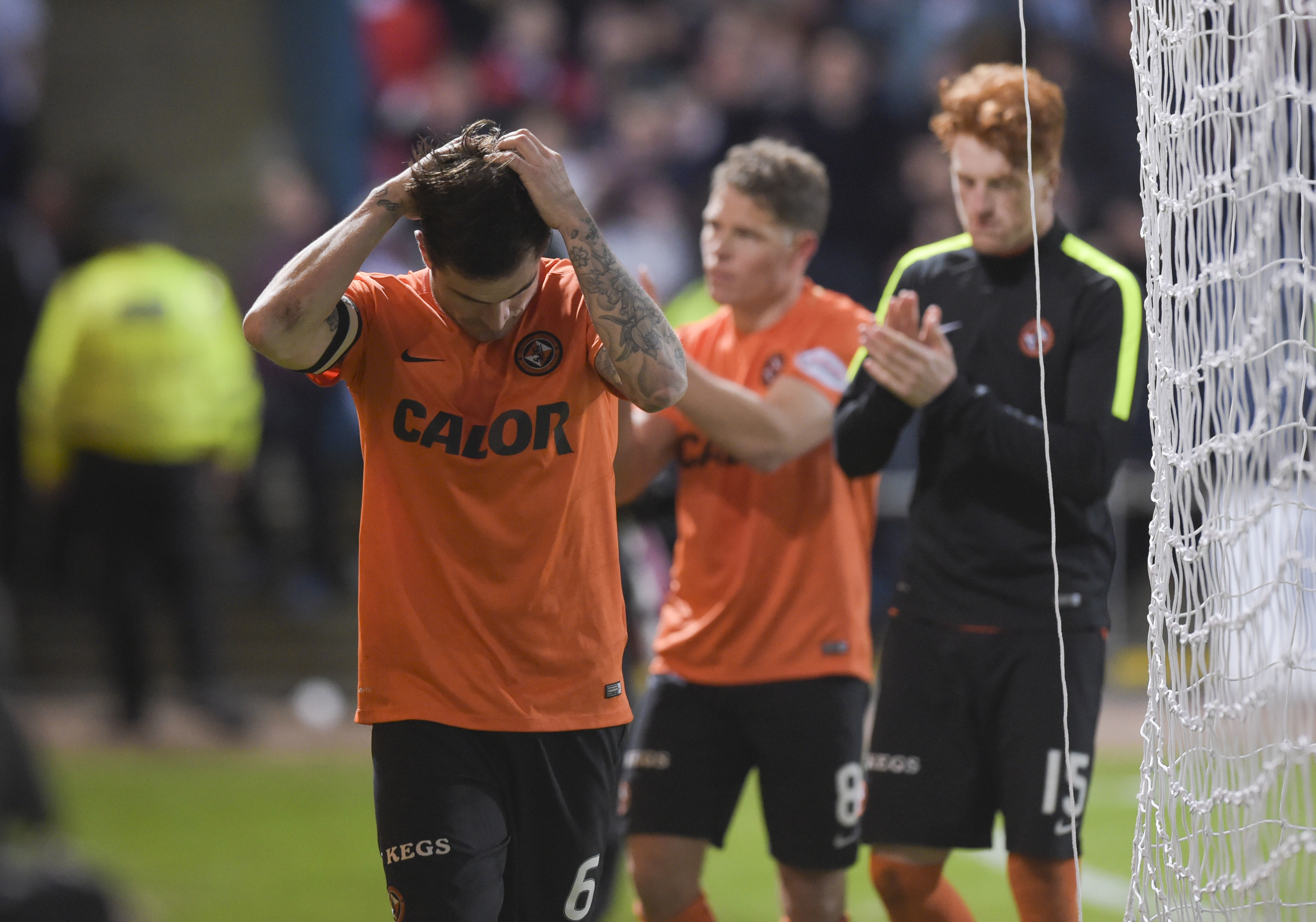 Paul Paton holds his head in his hands as the reality of relegation starts to sink in.