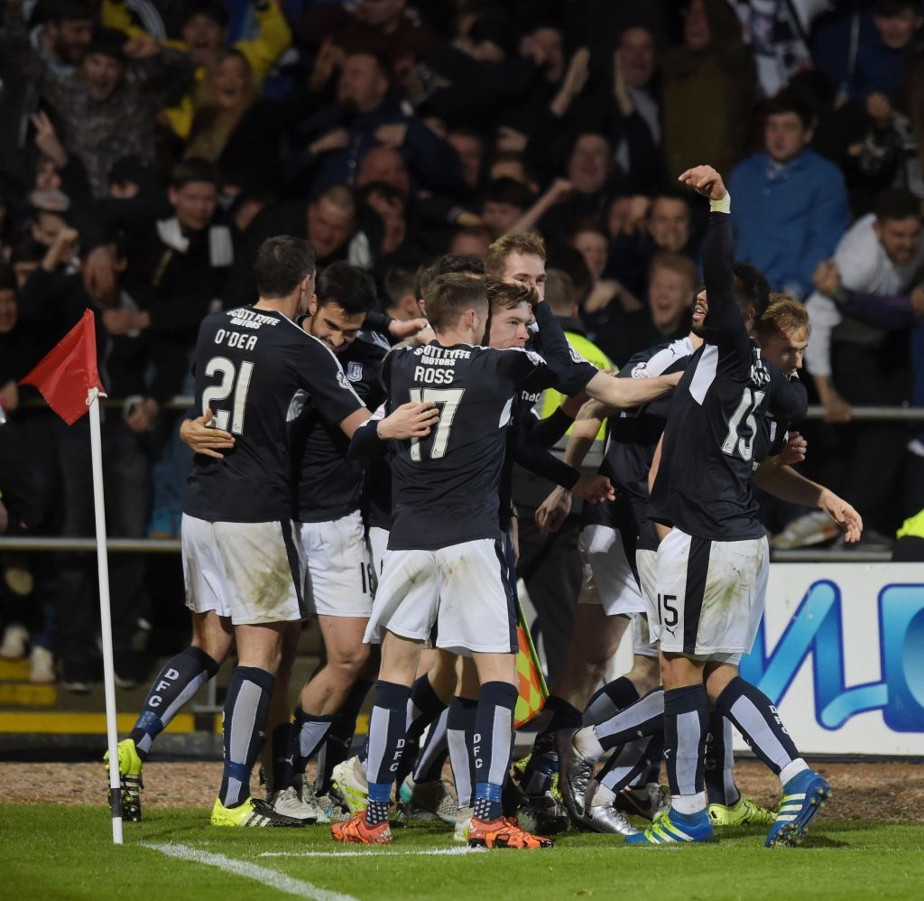 Craig Wighton is mobbed by team-mates.